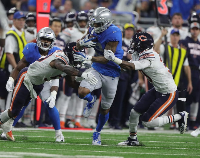 Lions receiver Kenny Golladay is tackled by Bears defenders during the second half of the Lions' 23-16 loss to the Bears on Thursday, Nov. 22, 2018, at Ford Field.
