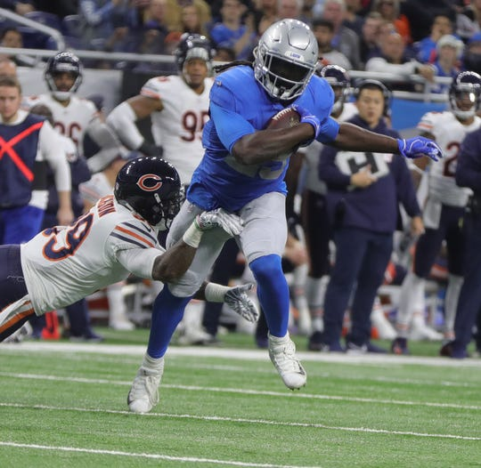 Lions running back LeGarrette Blount is tackled by Bears safety Eddie Jackson during the second half of the Lions' 23-16 loss to the Bears on Thursday, Nov. 22, 2018, at Ford Field.
