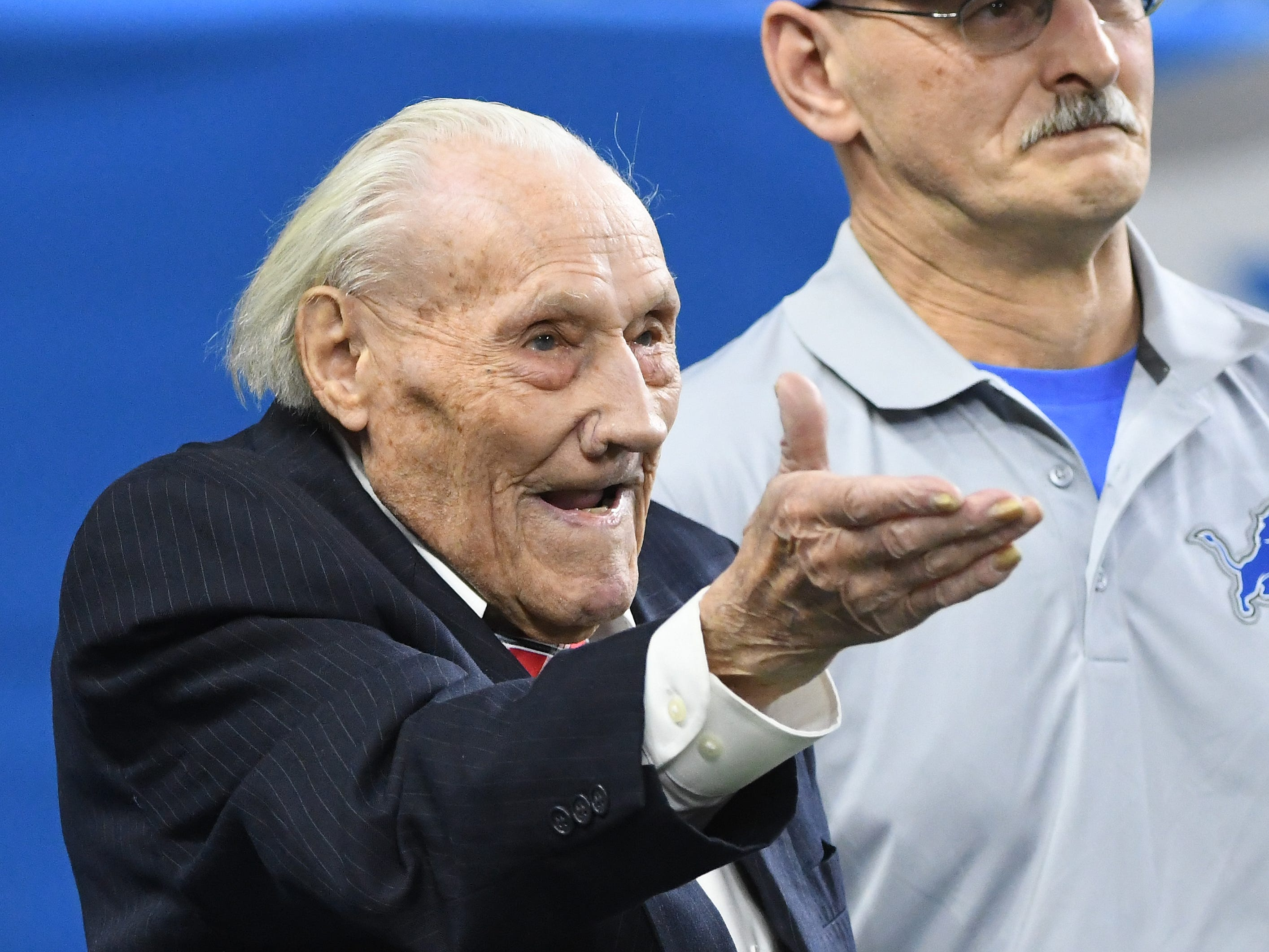 106 year old WWII U.S. Army photographer Stanley Wrona is recognized during a break in the action.