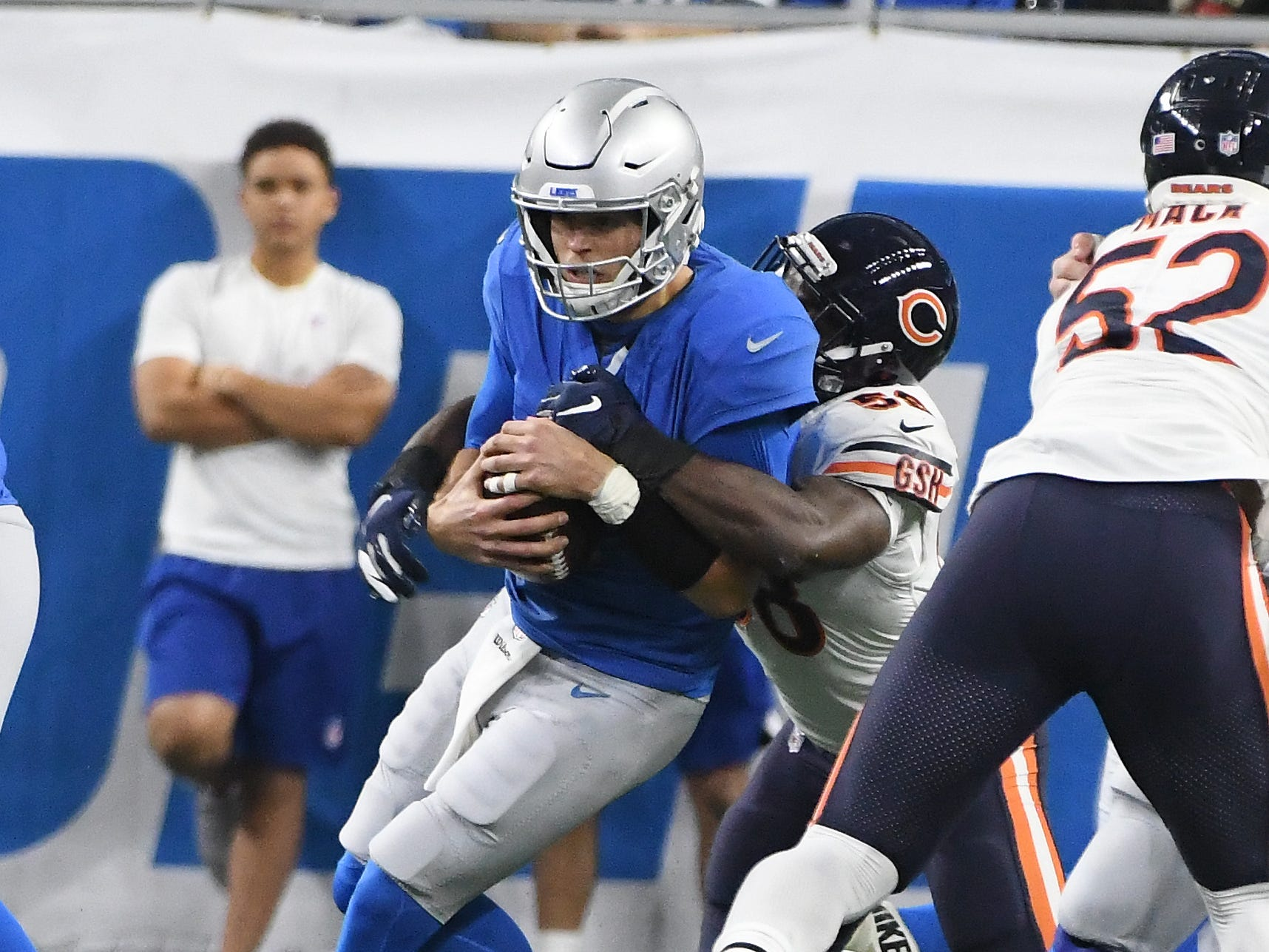 Lions quarterback Matthew Stafford gets sacked by Bears' Roquan Smith in the second quarter.