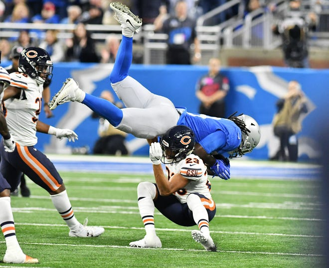 Bears' Kyle Fuller (23) upends Lions running back LeGarrette Blount during Thursday's game.