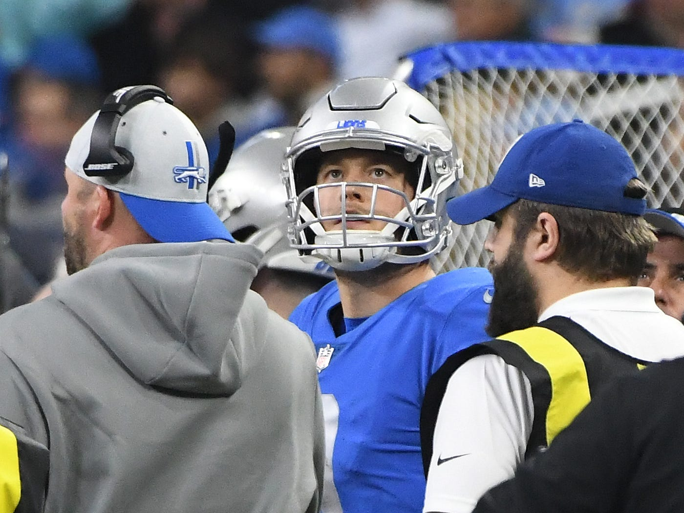 Lions quarterback Matthew Stafford looks up at the replay of his intercepted pass, intended for Lions' Michael Roberts late in the fourth quarter.