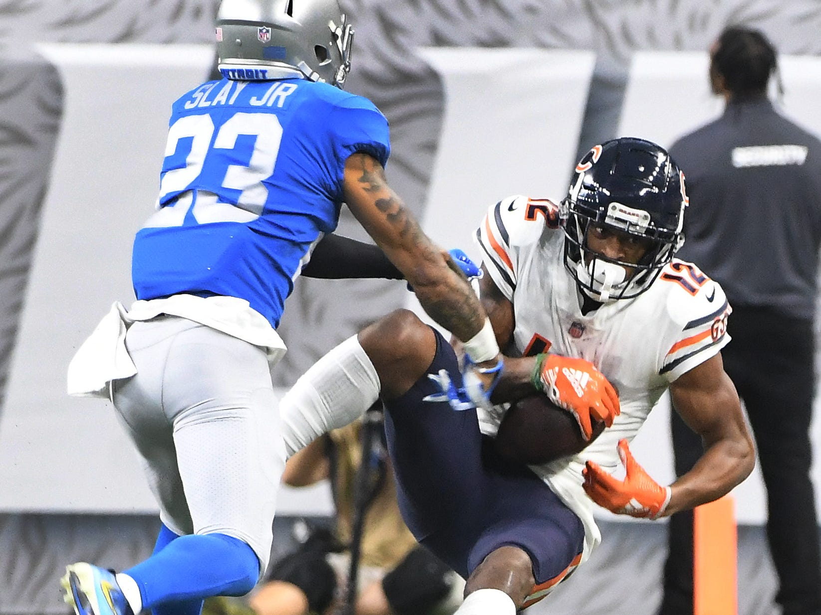 Bears' Allen Robinson II pulls in a reception over Lions' Darius Slaty in the second  quarter.
