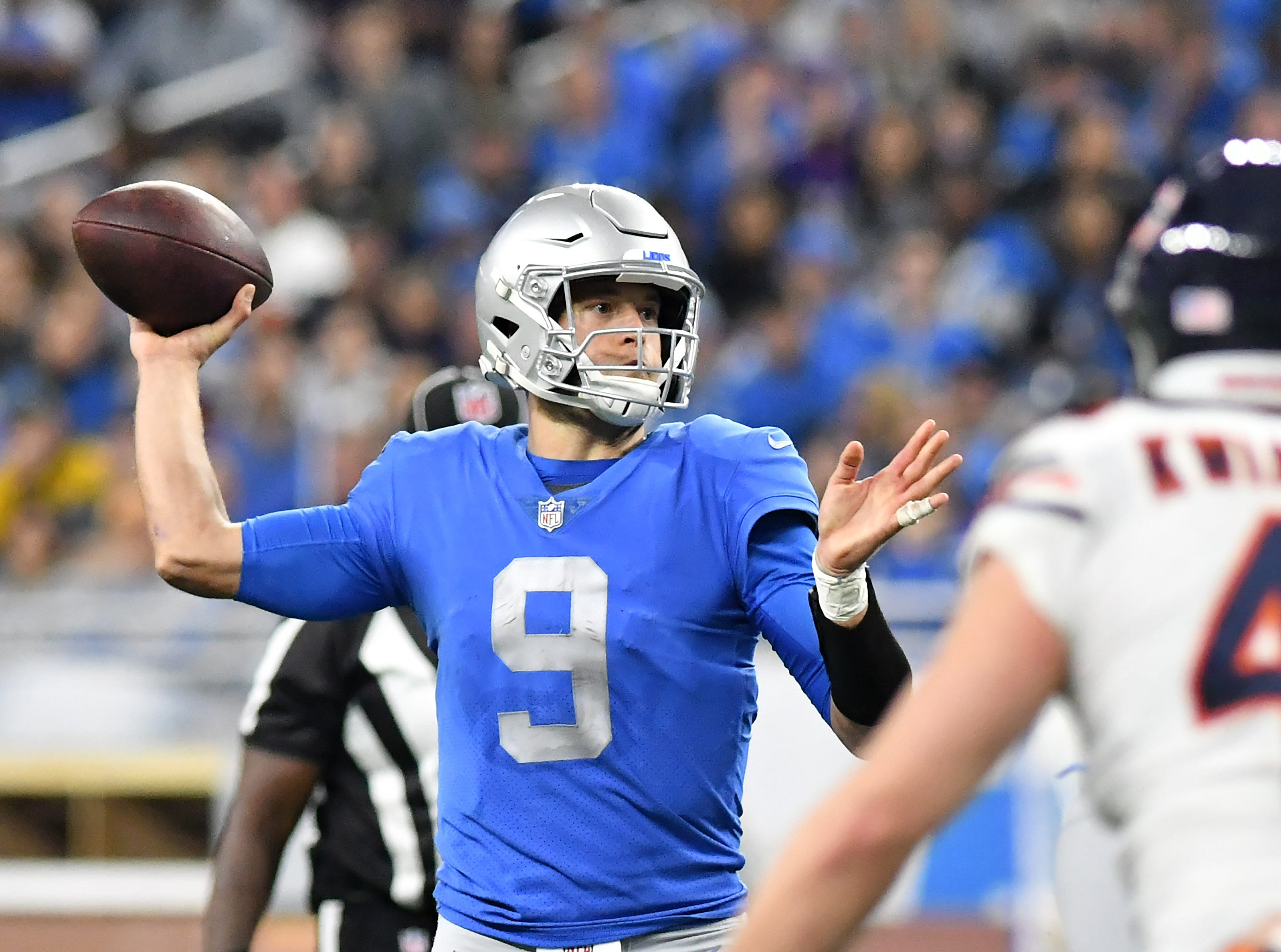 Lions quarterback Matthew Stafford looks for an open man late In the fourth quarter.  Detroit Lions vs Chicago Bears on Thanksgiving Day at Ford Field in Detroit on Nov. 22, 2018.  Bears win, 23-16.(Robin Buckson / Detroit News)