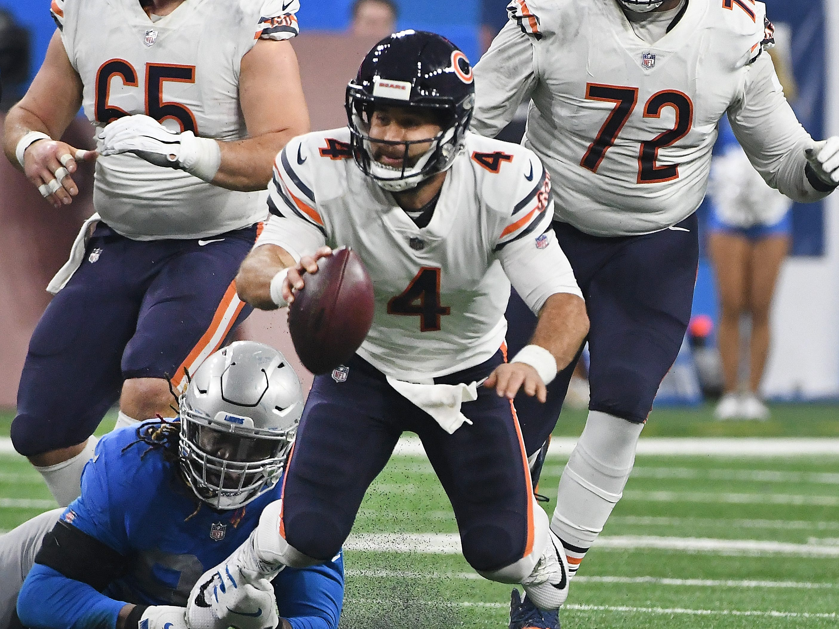 Bears quarterback Chad Daniel is sacked by Lions' Ezekiel Ansah in the third quarter.