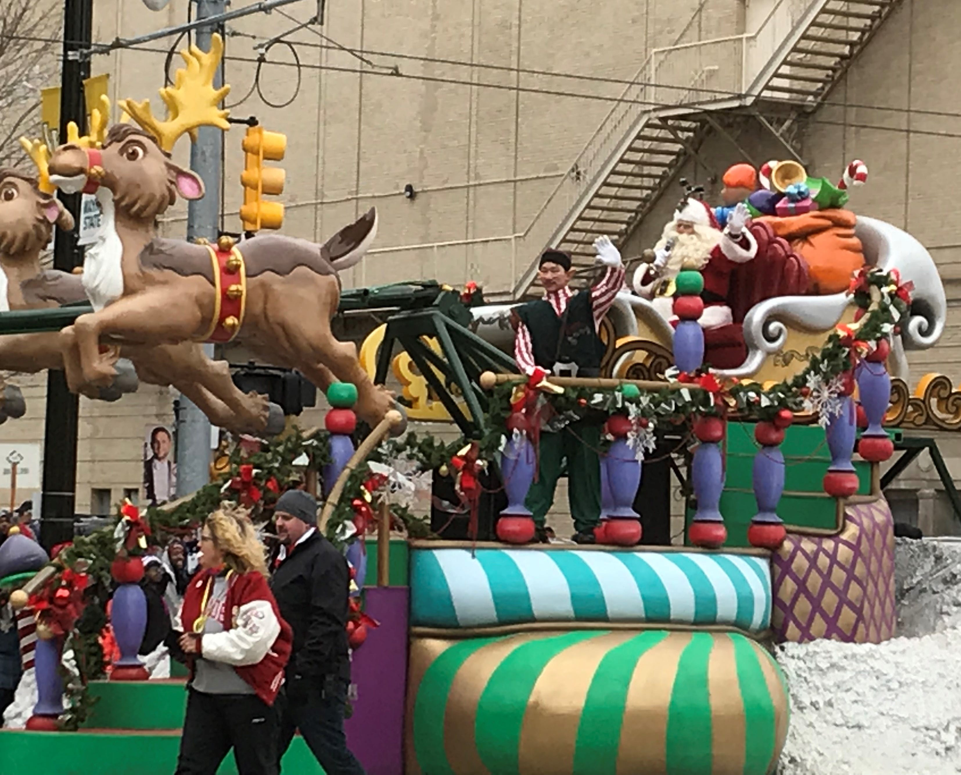 Santa Claus gets a float of his own as he heads south on Woodward to officially start the holiday season.