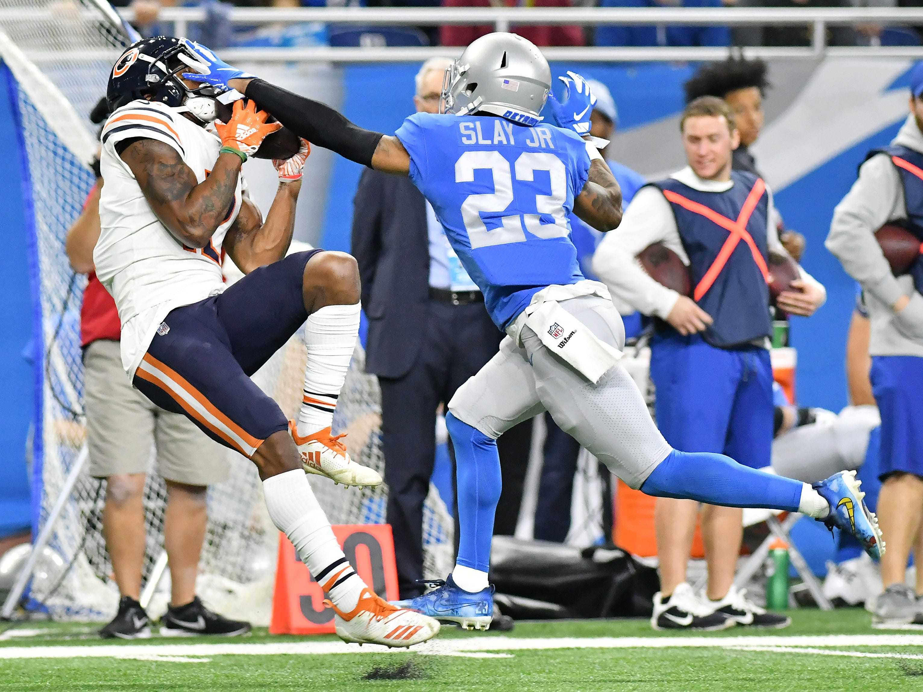 Lions' Darius Slay (23) defends a catch by Bears'  Allen Robinson II, left, n the second quarter.