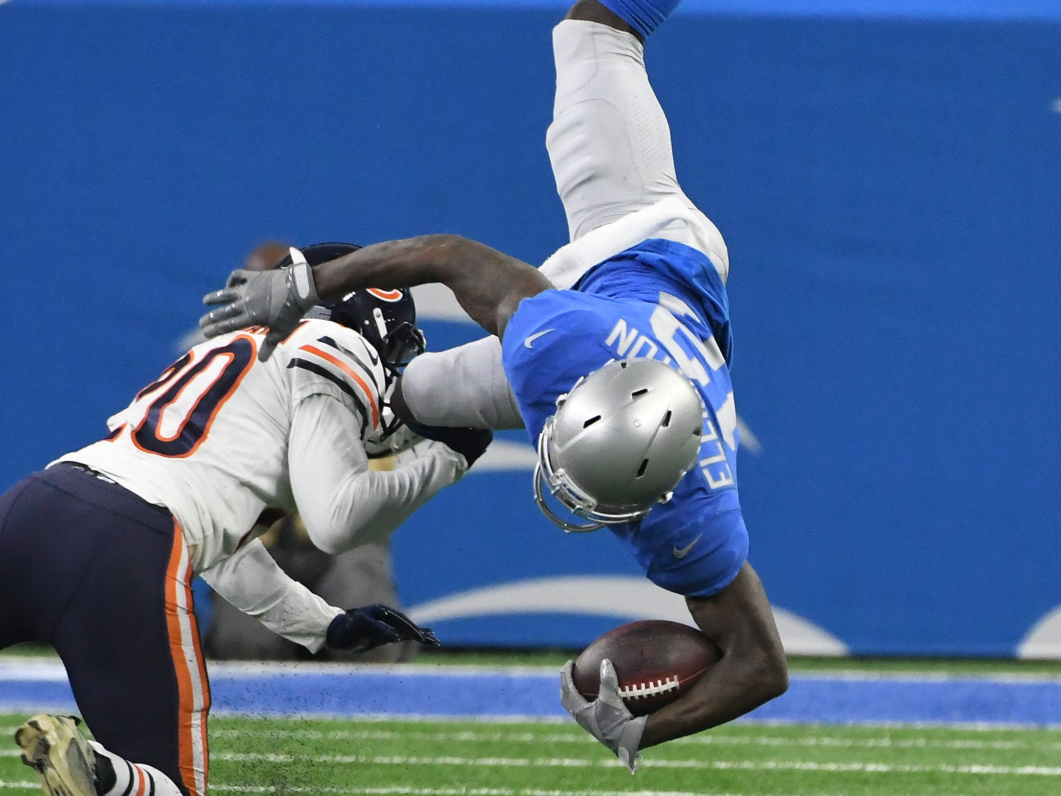 Lions' Bruce Ellington is upended by Bears' Prince Amukamara in the second quarter.