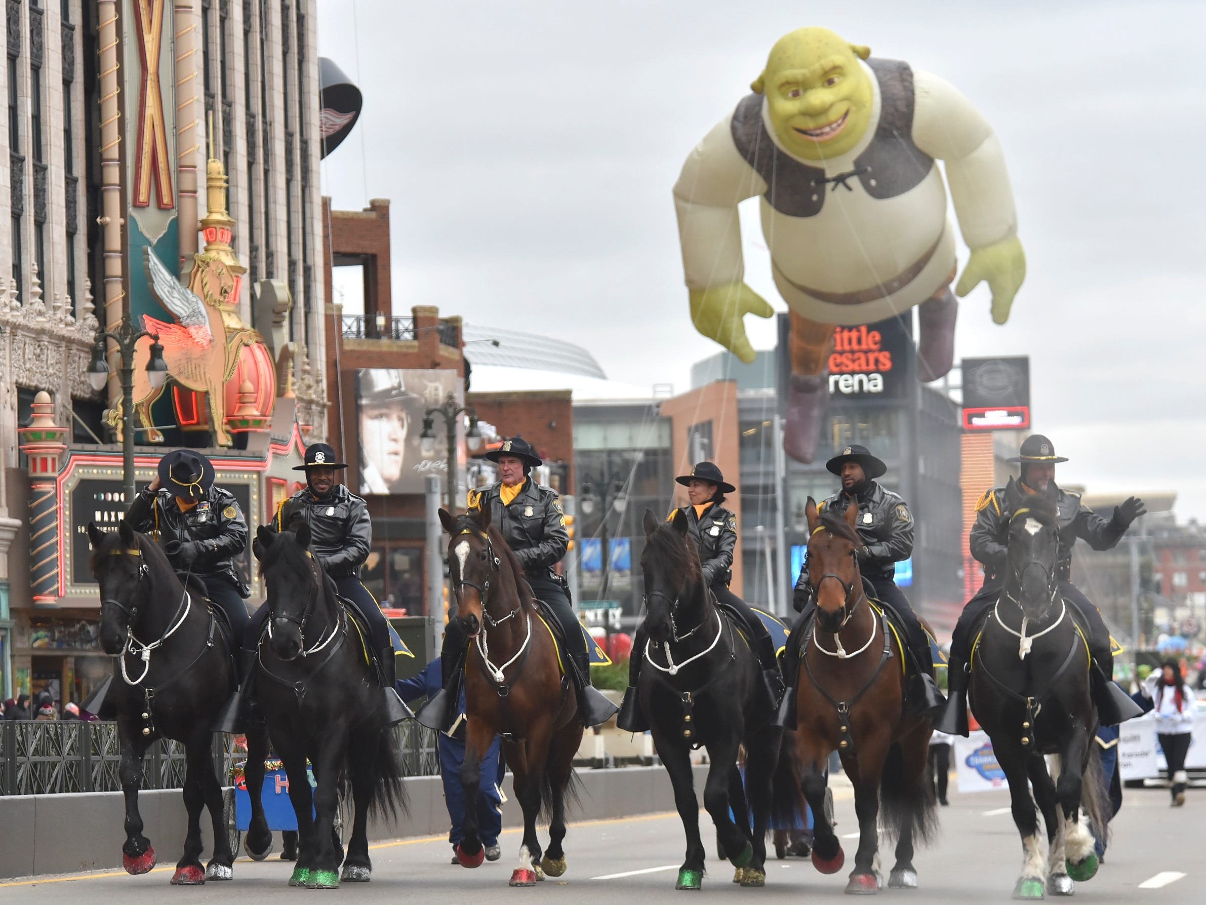 The Detroit Police Department Mounted Unit rides at the front of the parade.