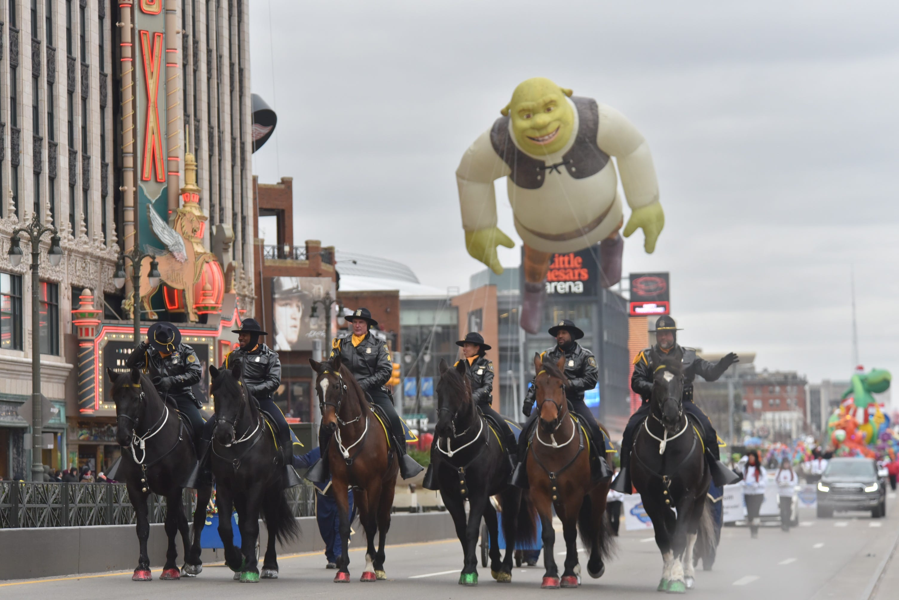 Members of the Detroit Police Mounted Unit head down the parade route.