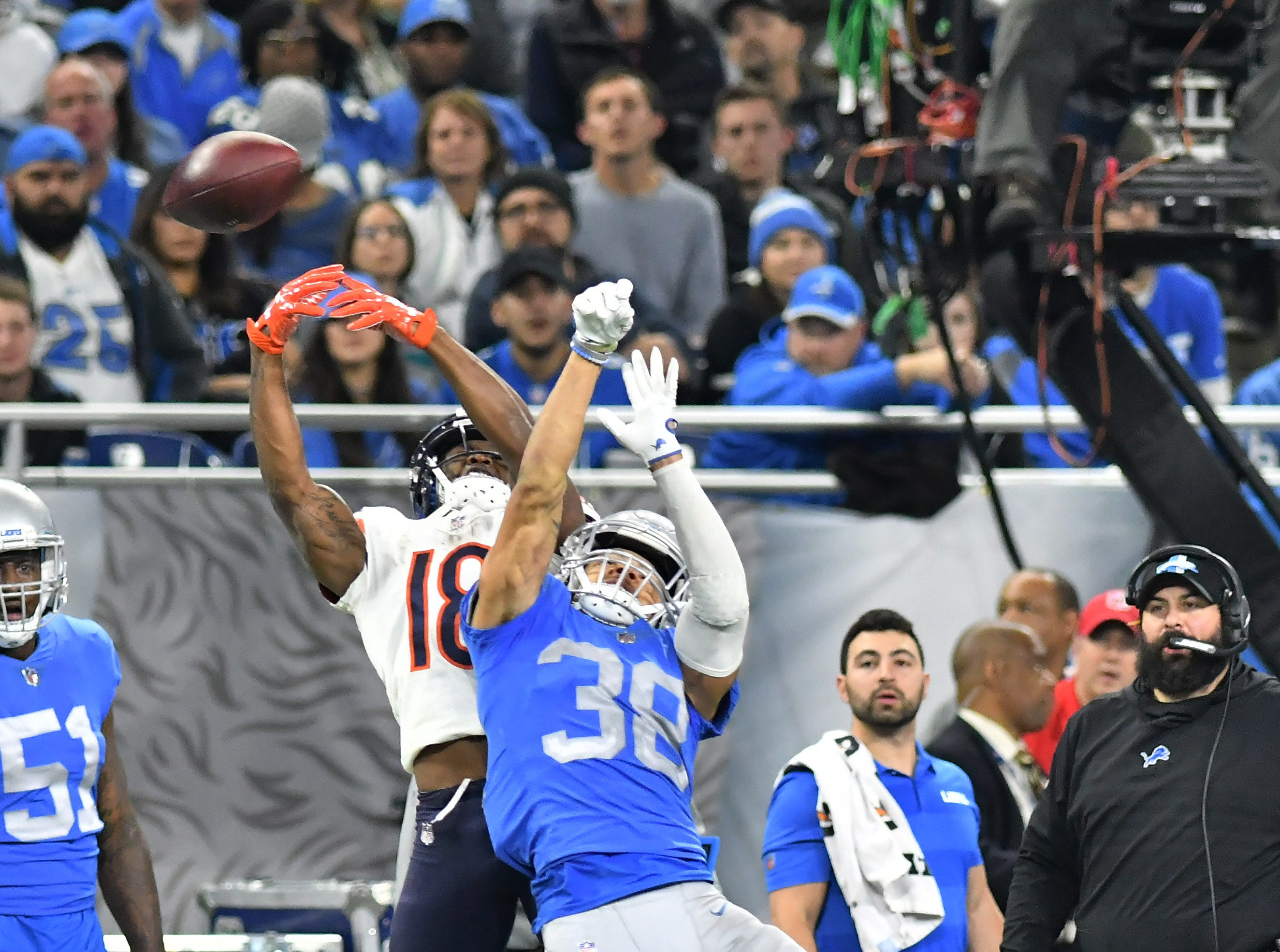 Lions' Mike Ford (38) breaks up a pass intended for Bears' Taylor Gabriel In the fourth quarter.  Detroit Lions vs Chicago Bears on Thanksgiving Day at Ford Field in Detroit on Nov. 22, 2018.  Bears win, 23-16.