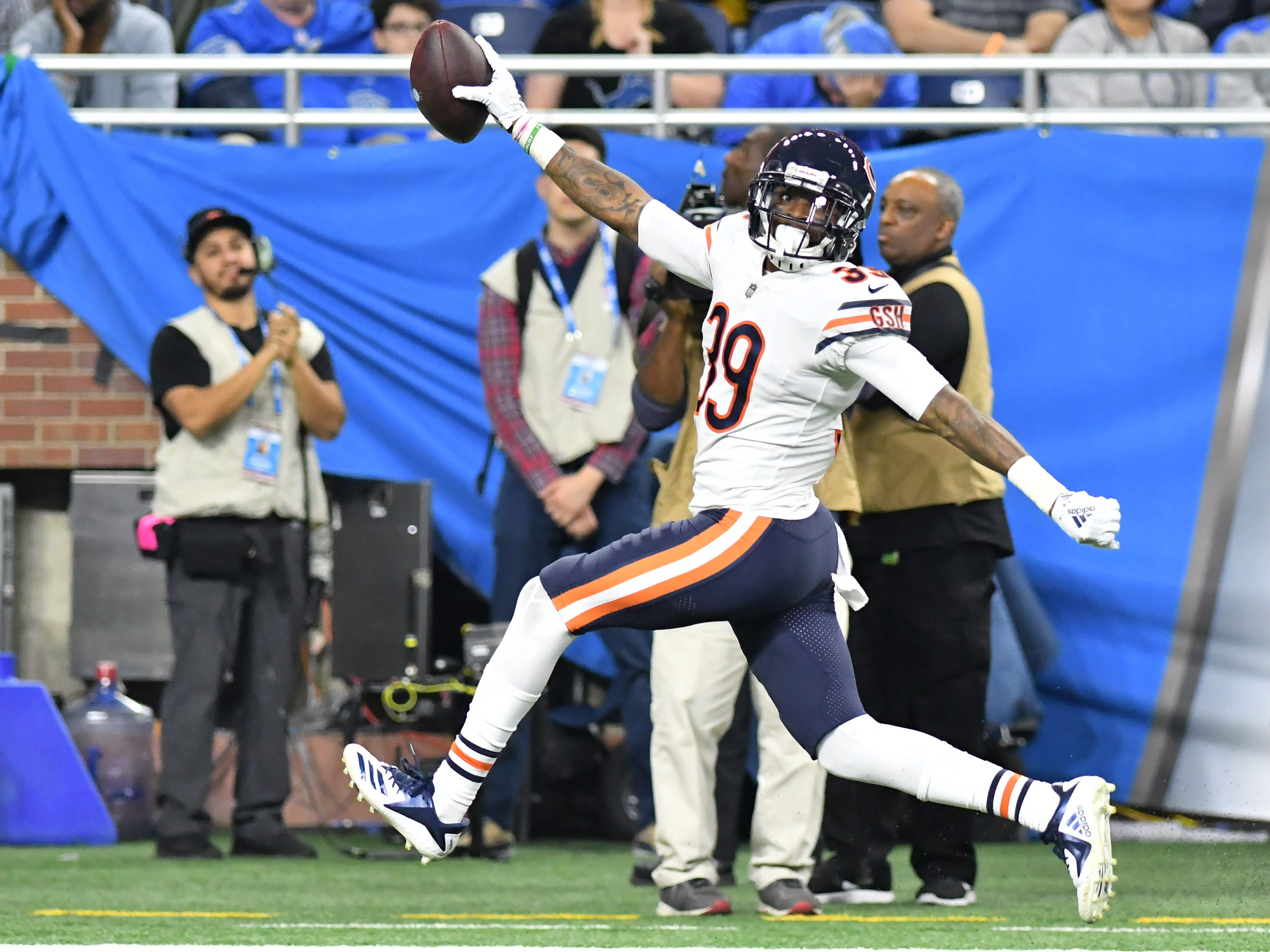 Bears' Eddie Jackson looks back as he takes his interception towards the end zone to score In the fourth quarter.