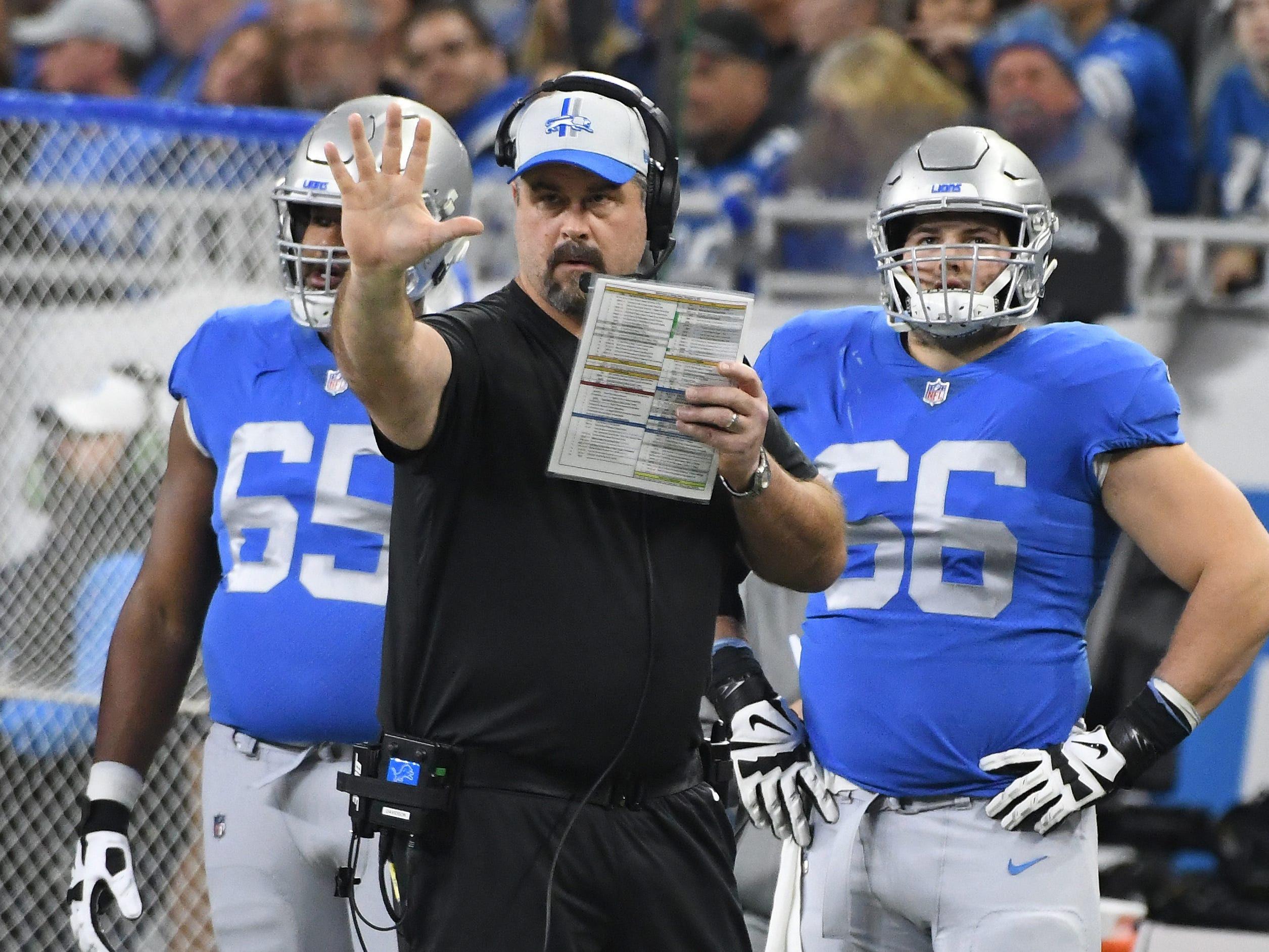 Lions offensive line coach Jeff Davidson works the sidelines in the first quarter.