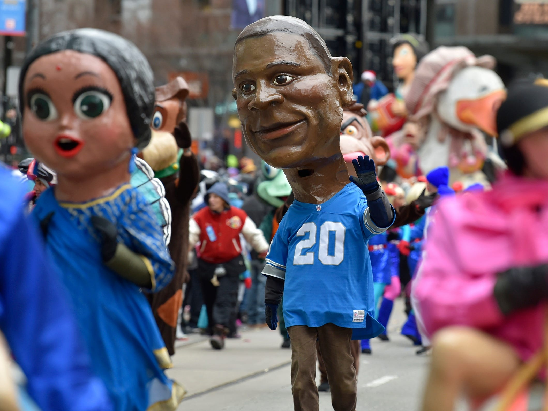 Barry Sanders is one of 80 paper mache heads from the Big Head Corps.