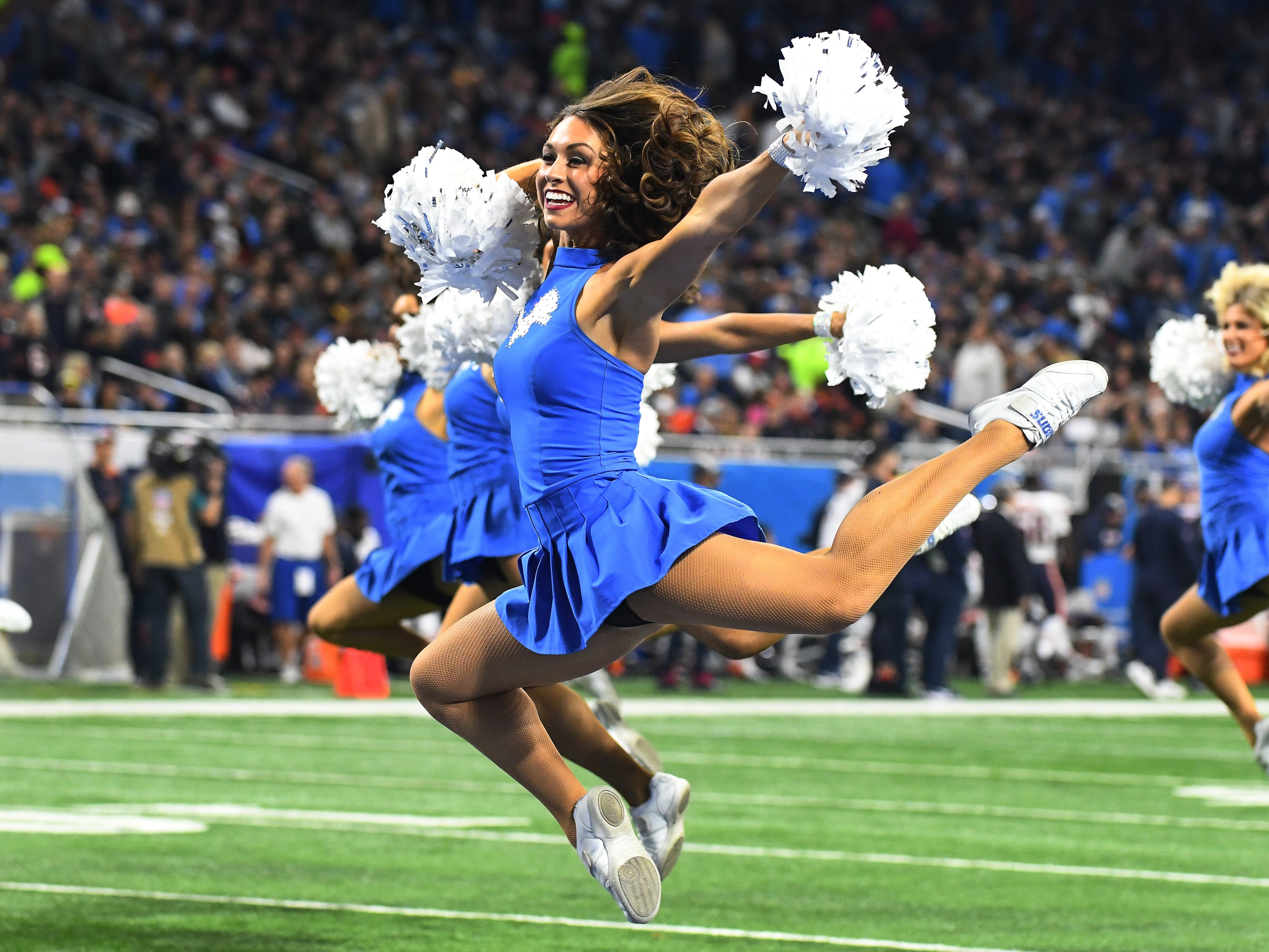 Detroit Lions Cheerleaders perform during a break in the action between quarters.