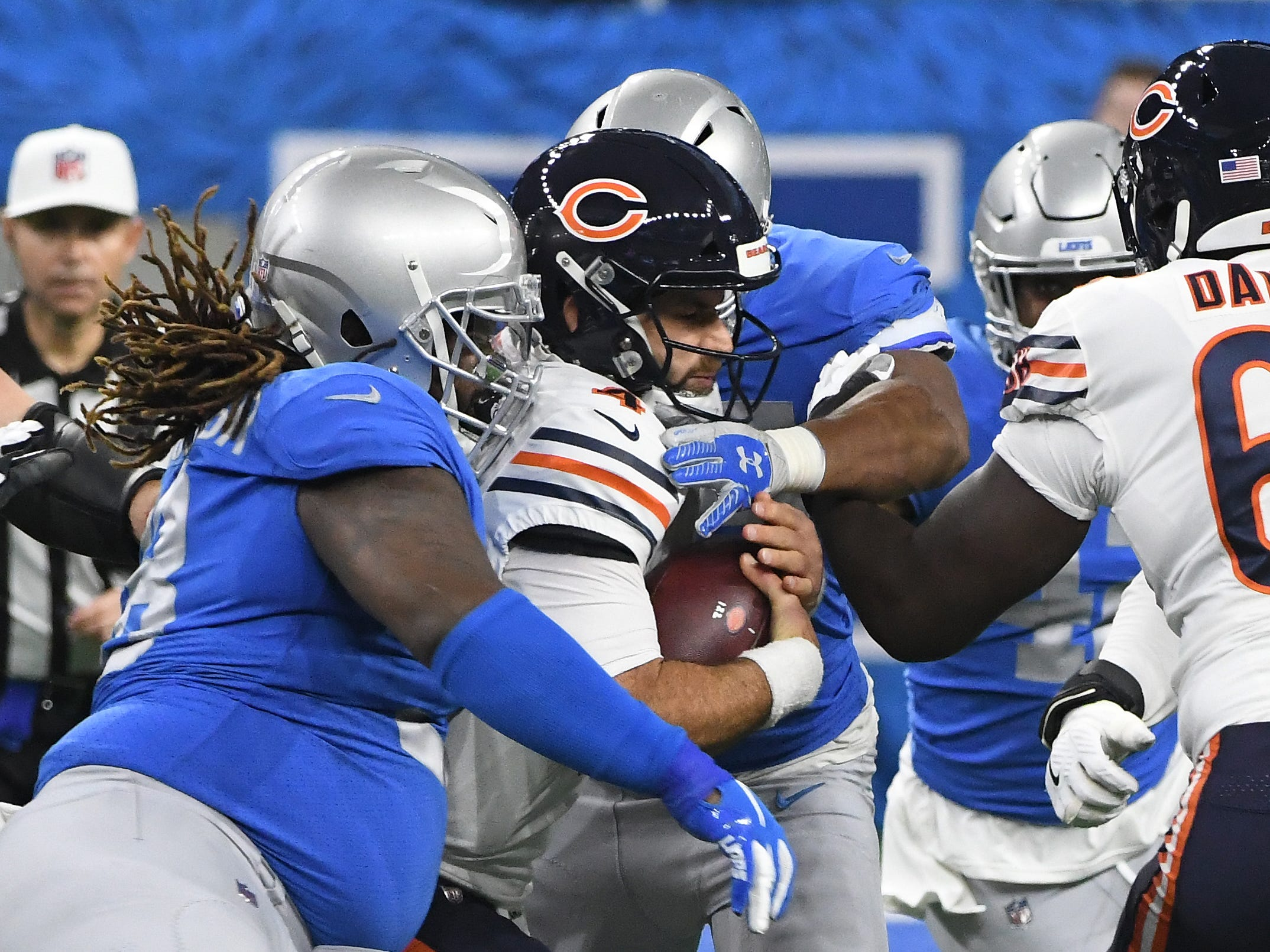 Bears quarterback Chase Daniel is sacked by Lions' Romeo Okwara and Damon Harrison Sr. in the first quarter.