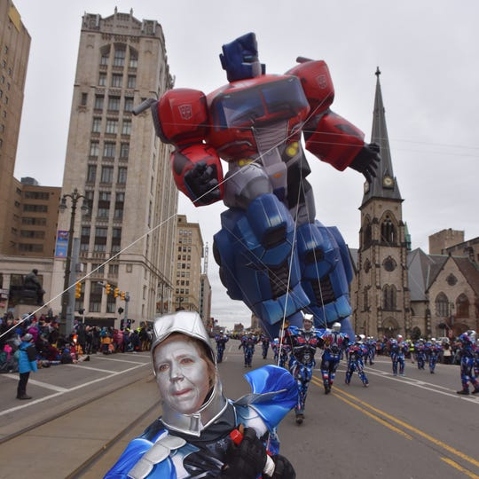 Volunteer Sarah Mickowski of New Baltimore helps keep the Optimus Prime balloon from transforming into a fly away fiasco.