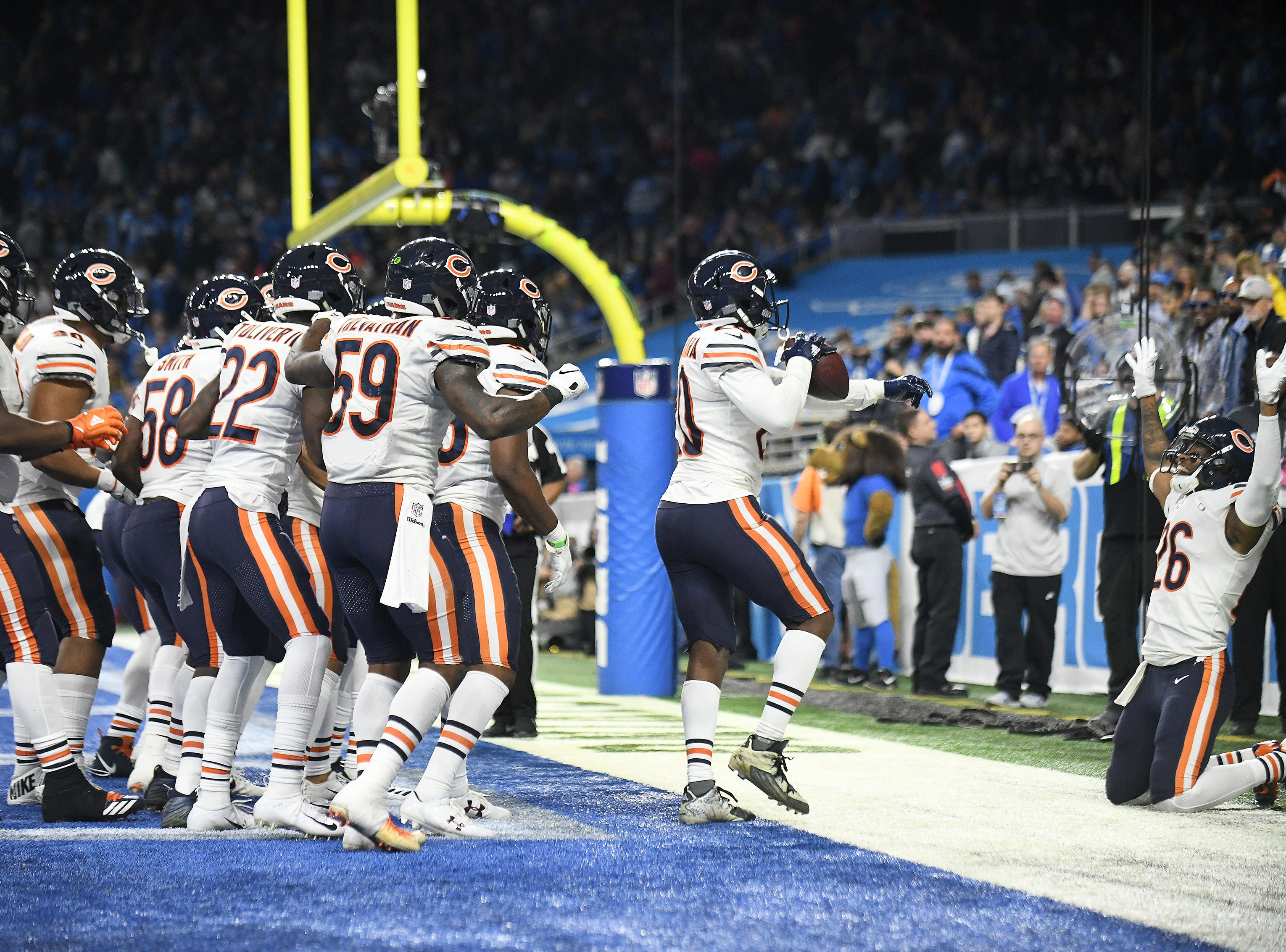 Chicago Bears do a group celebration after Kyle Fuller made an interception in the Lions end zone In the fourth quarter.  Detroit Lions vs Chicago Bears on Thanksgiving Day at Ford Field in Detroit on Nov. 22, 2018.  Bears win, 23-16.(Robin Buckson / Detroit News)