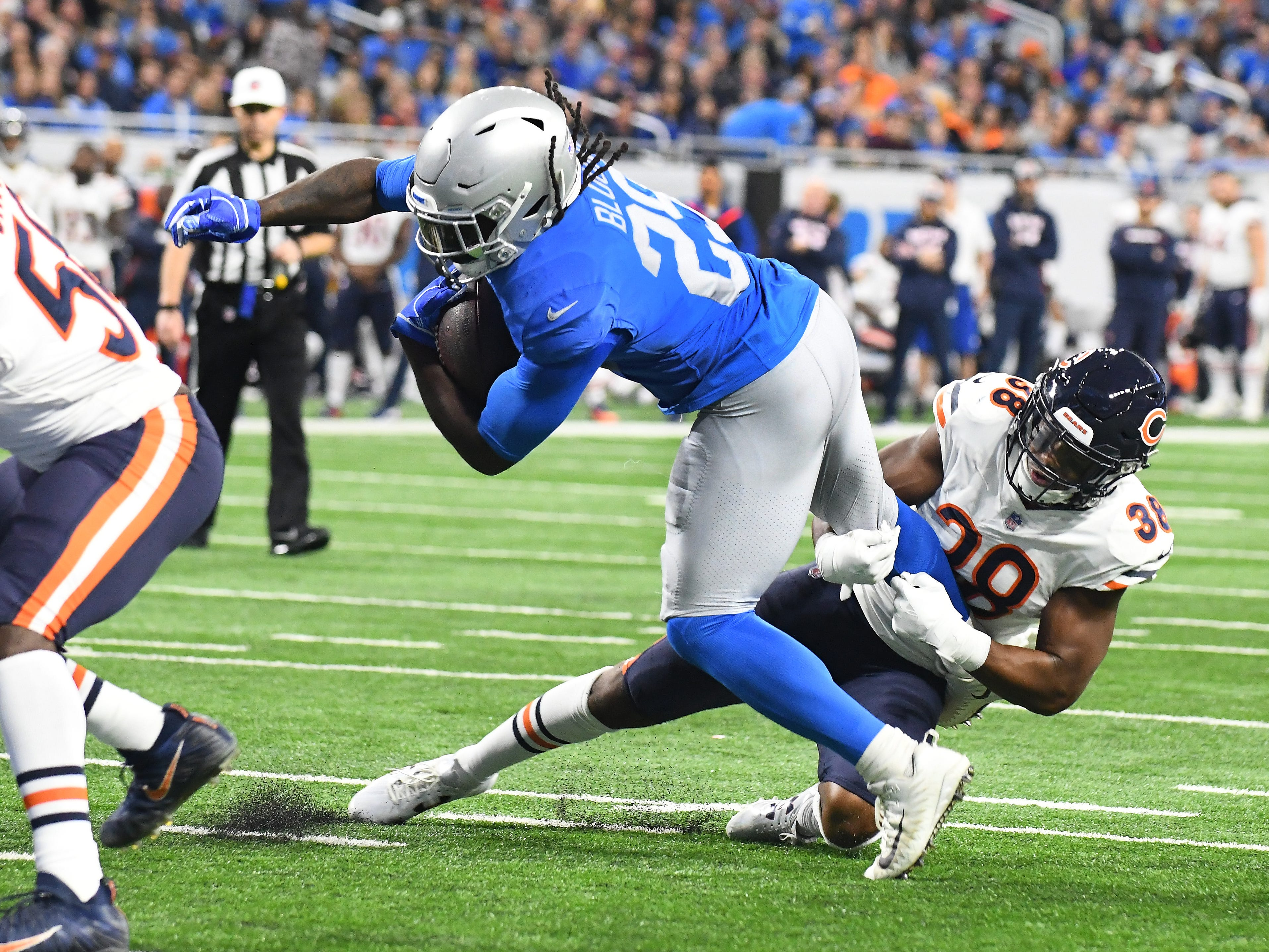 Despite Bears' Adrian Amos Jr. all over Lions running back LeGarrett Blount, Blount charges into the end zone for a touchdown  in the second quarter.