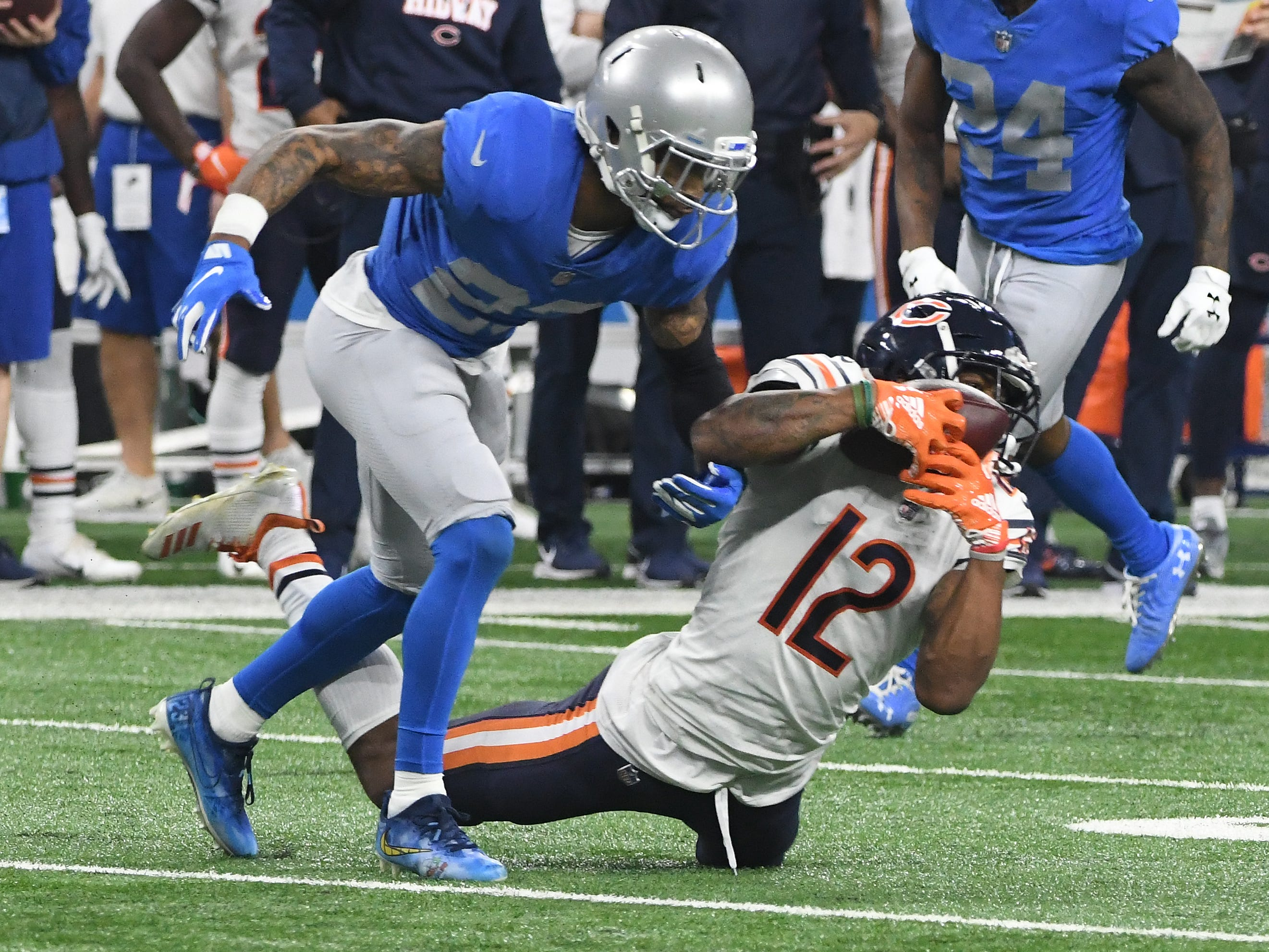 Bears' Allen Robinson II pulls in a low pass in front of Lions Darius Slay in the third quarter.