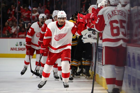 Andreas Athanasiou of the Detroit Red Wings celebrates his third-period goal with teammates on Wednesday night.