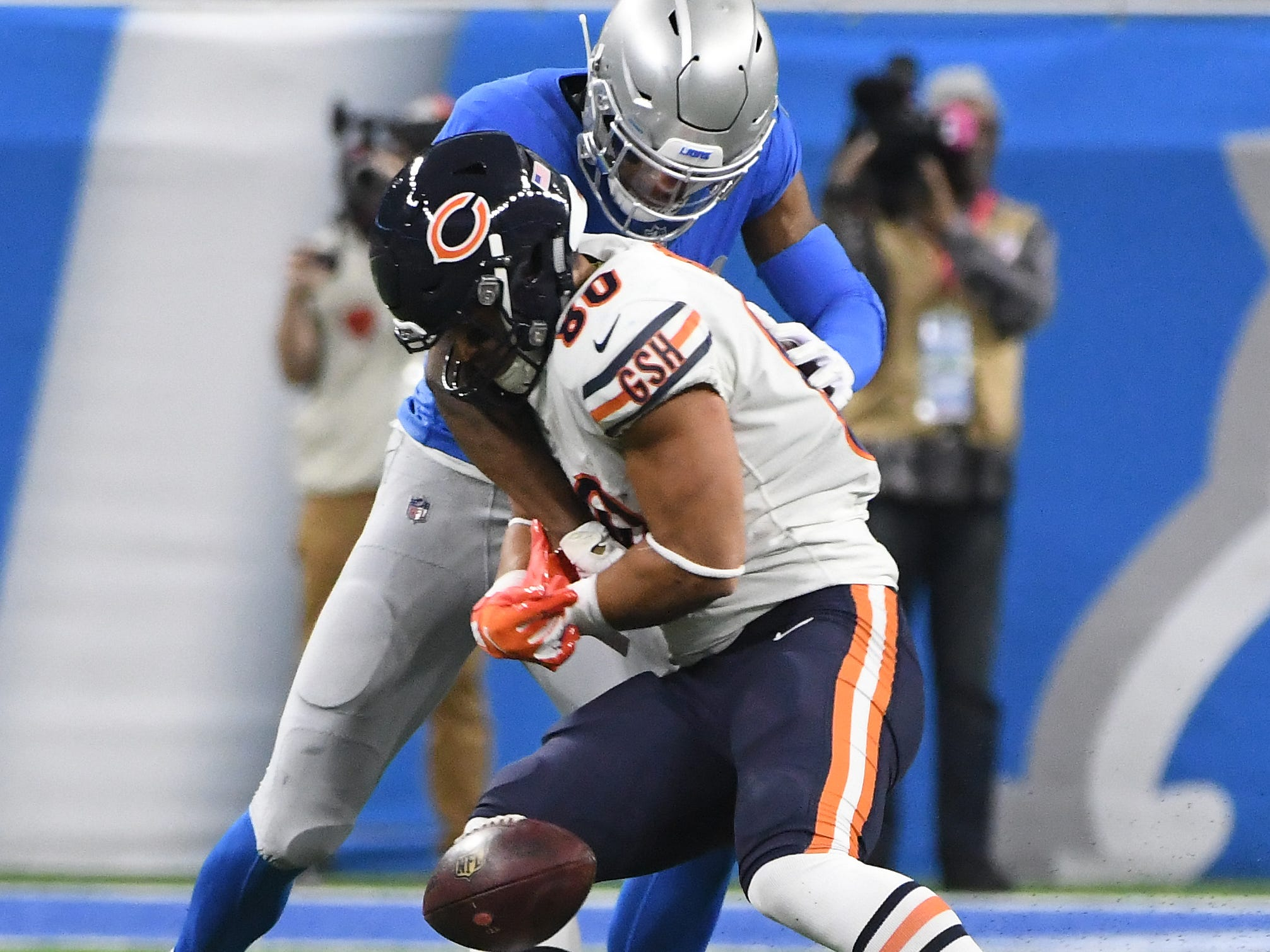 Lions' DeShawn Shead punches the ball out of Bears' Trey Burtons arms and Lions' Jarrad Davis recovers in the second quarter.
