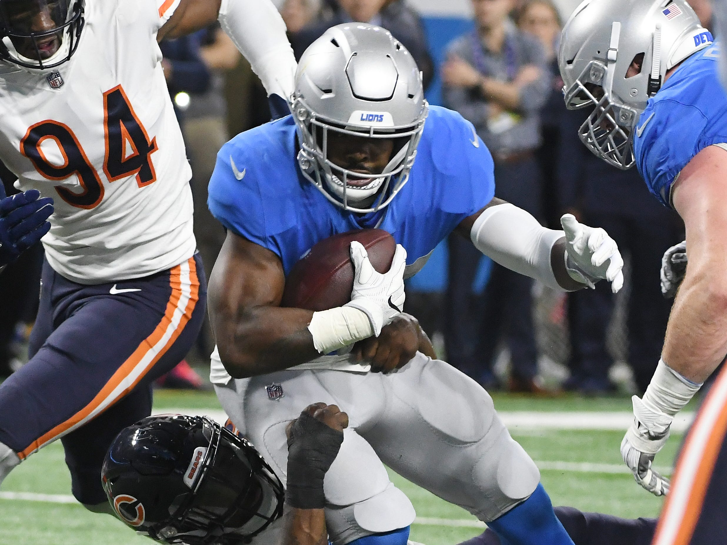 Lions' Theo Riddick continues to work up field on a run in the second quarter.