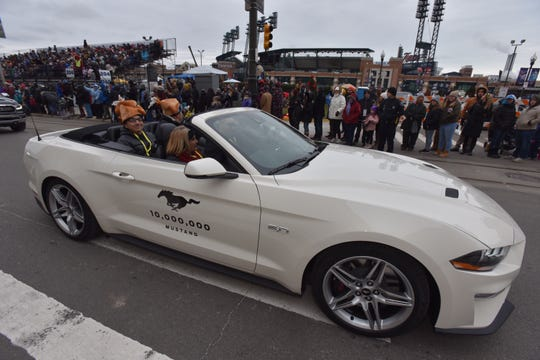 The 10 millionth production Ford Mustang  glides down Woodward near Comerica Park.
