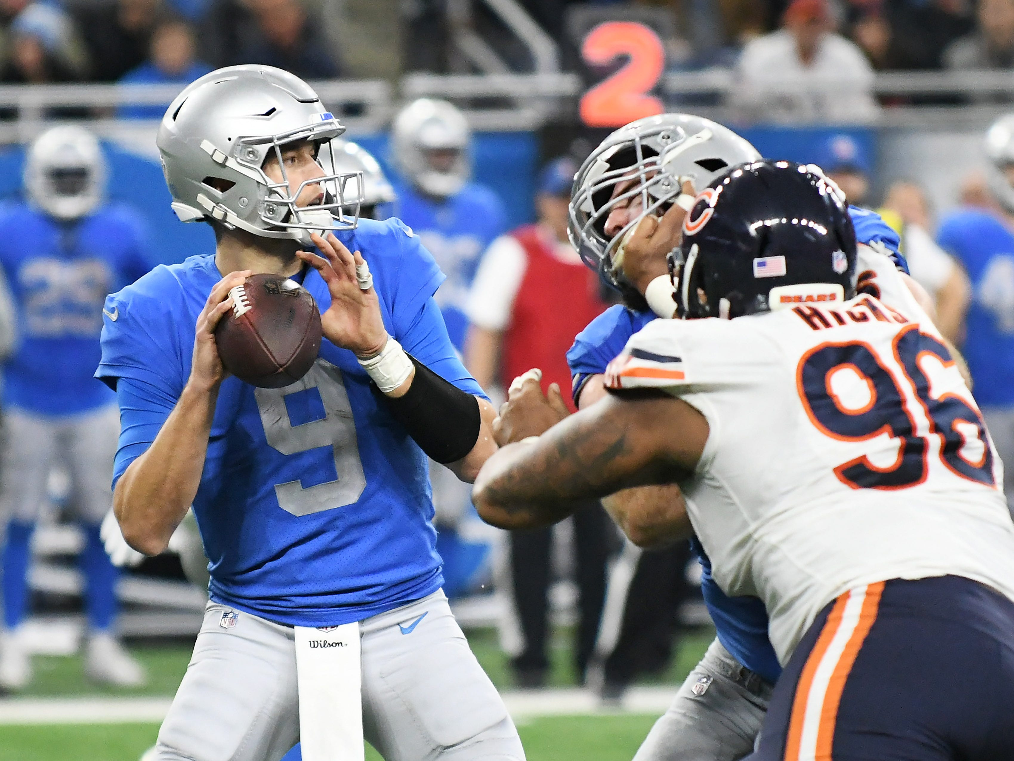 Lions quarterback Matthew Stafford looks to pass the ball In the fourth quarter.  Detroit Lions vs Chicago Bears on Thanksgiving Day at Ford Field in Detroit on Nov. 22, 2018.  Bears win, 23-16.