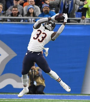 Taquan Mizzell scored Chicago's first touchdown on a 10-yard reception late in the first half on Thursday.