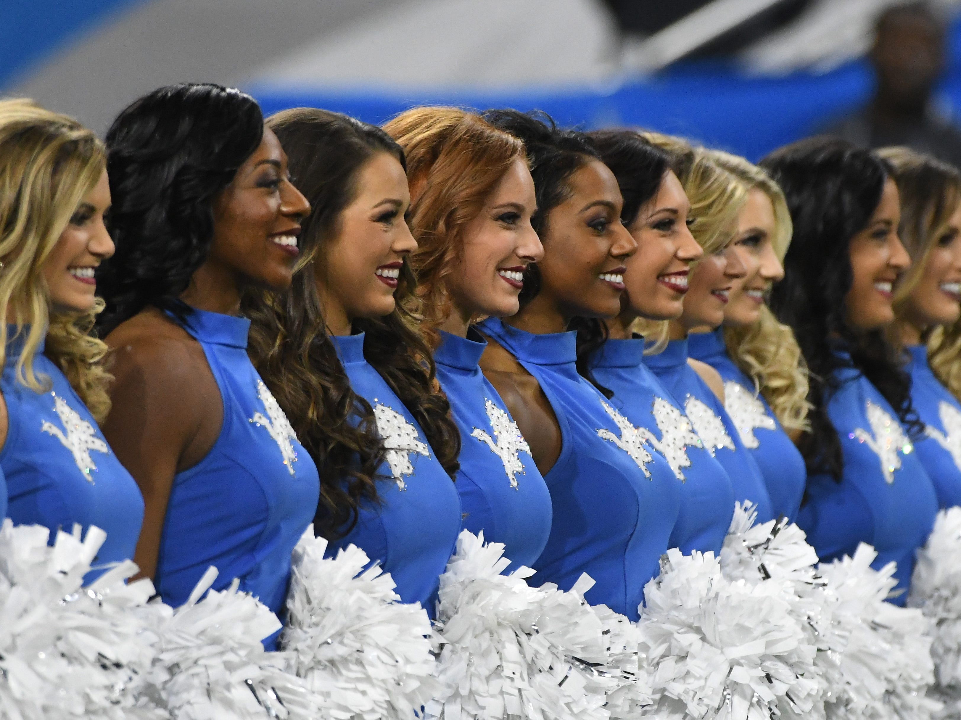 A sea of smiling Lions cheerleaders during the pregame ceremony between Detroit and the Chicago Bears.
