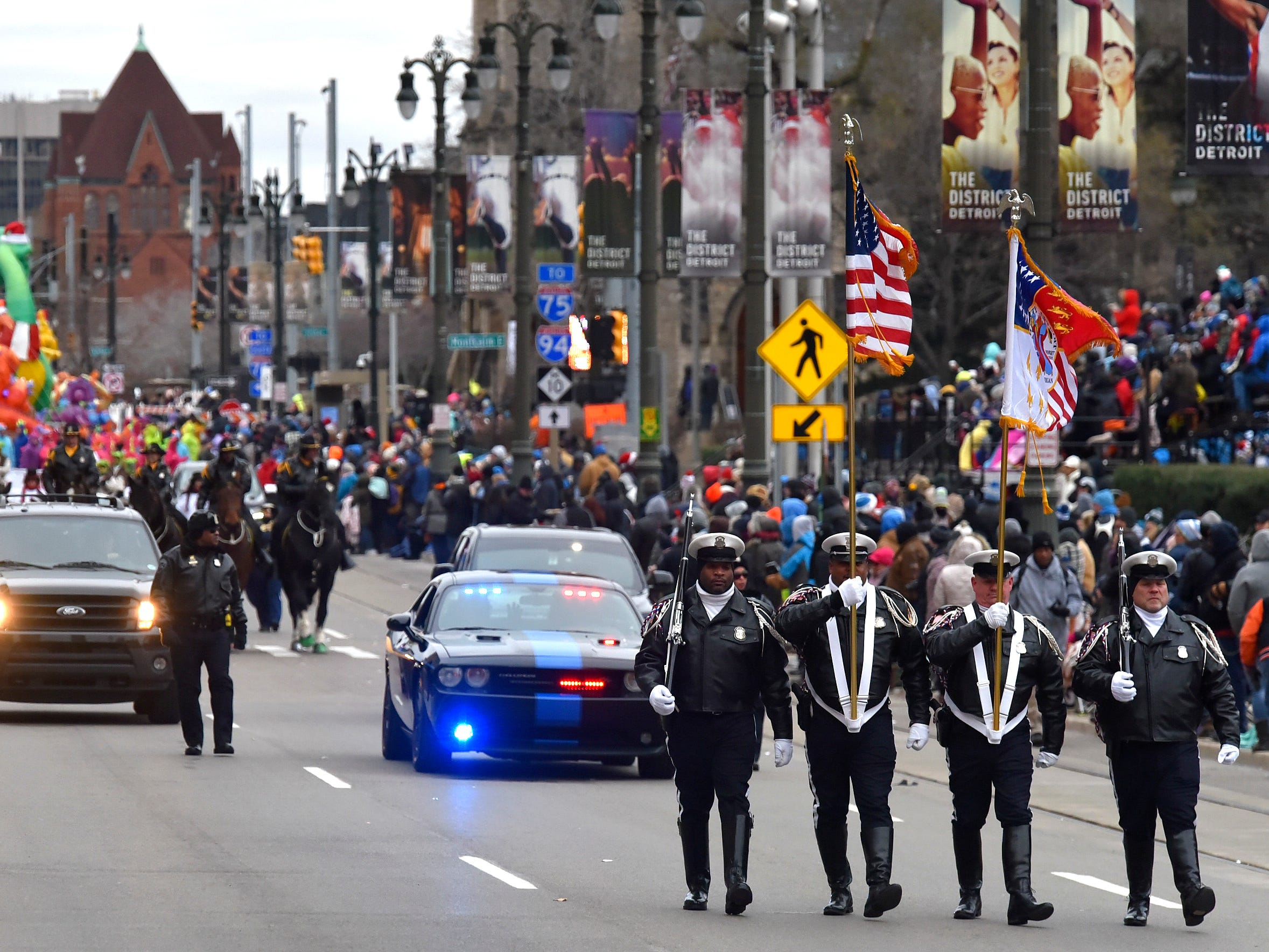 Officers from the Detroit Police Department Color Guard lead the 92nd America's Thanksgiving Day Parade in Detroit, Thursday, Nov. 22, 2018.