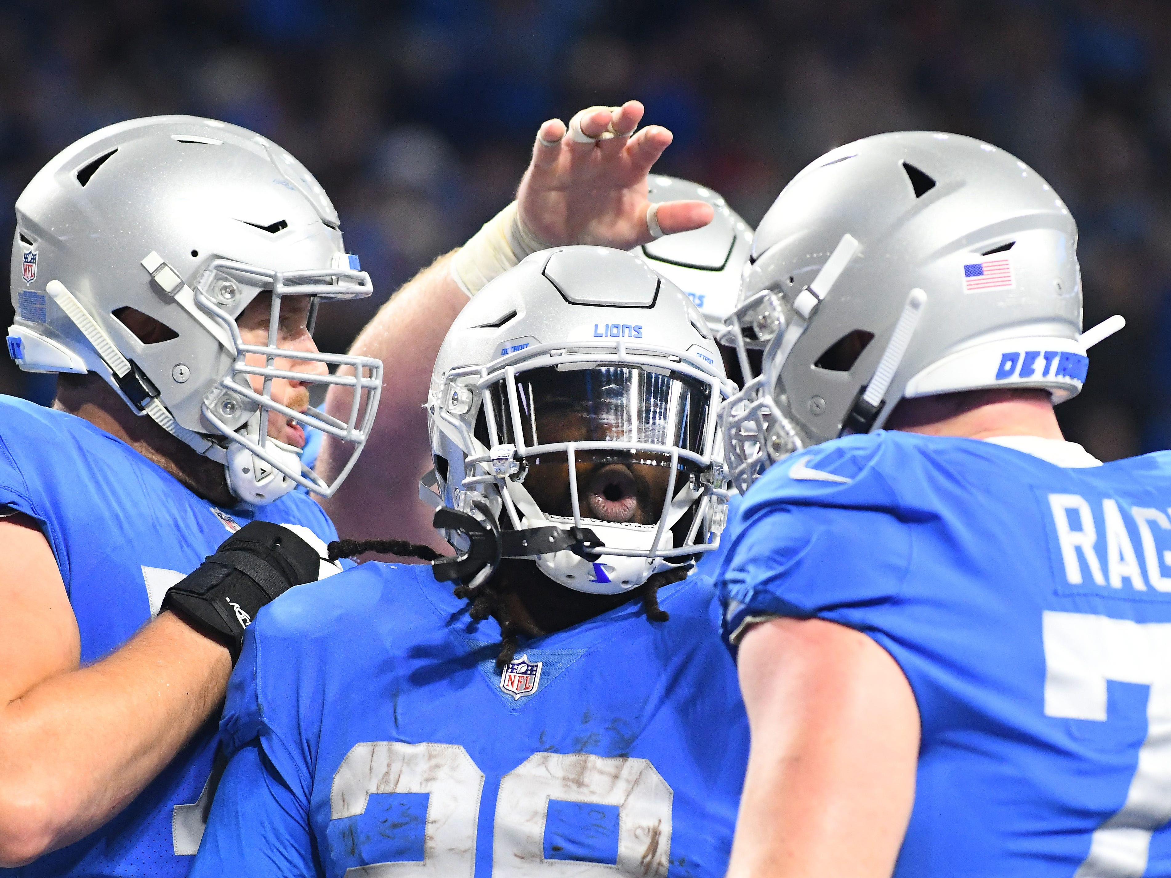 Lions running back LeGarrette Blount celebrates his touchdown run in the second quarter.