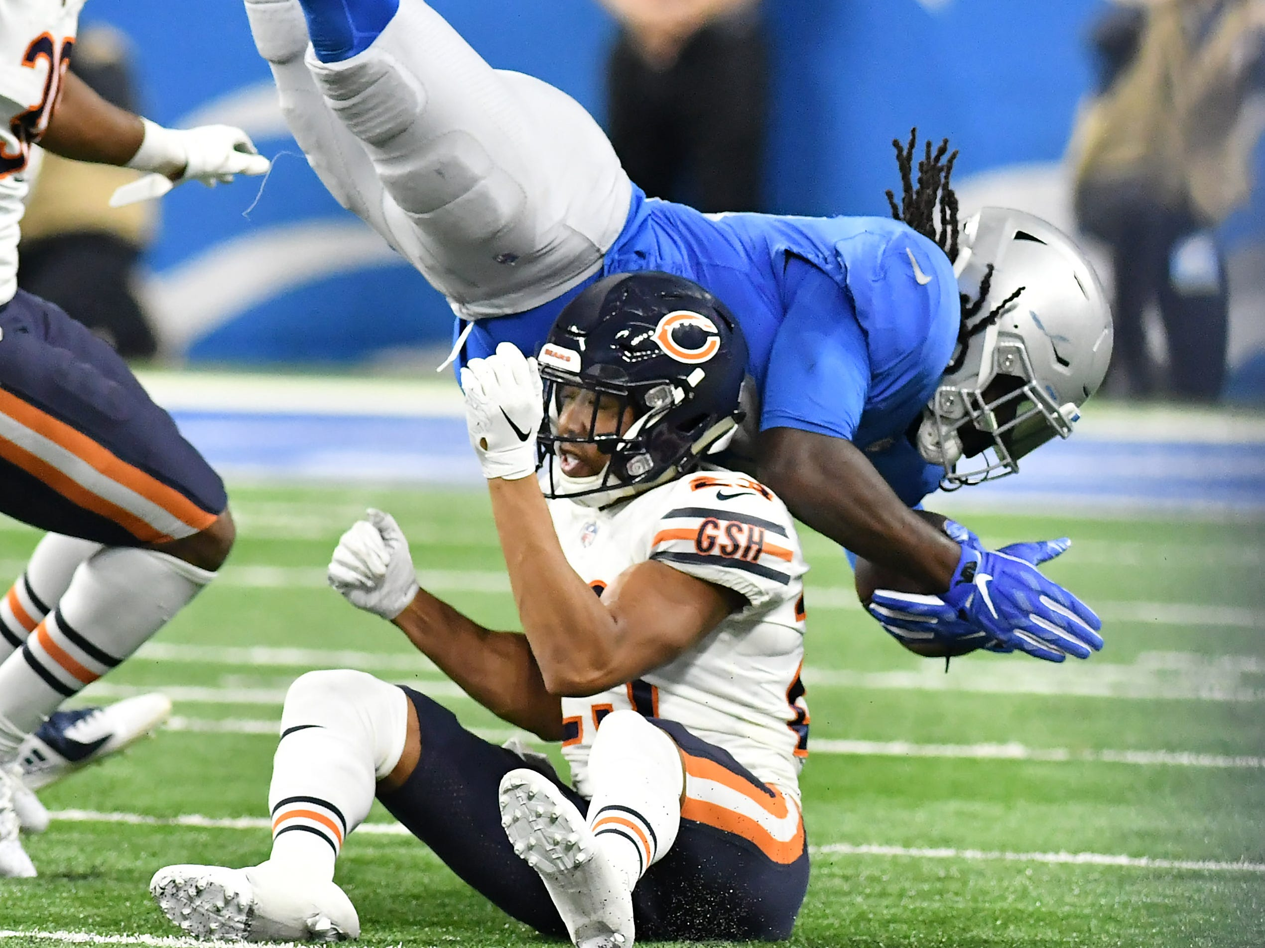 Bears' Kyle Fuller (23) upends Lions running back LaGarrette Blount on a run In the fourth quarter.