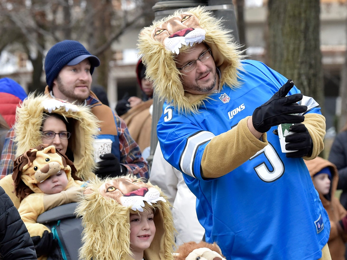 The Konopka family, including, Patrick, left, 11-months-old, mother, Jessica, Lucas, 8, Caroline, 5, and father Eric, all of Northville, dress up in Detroit Lions outfits before they attend the game.