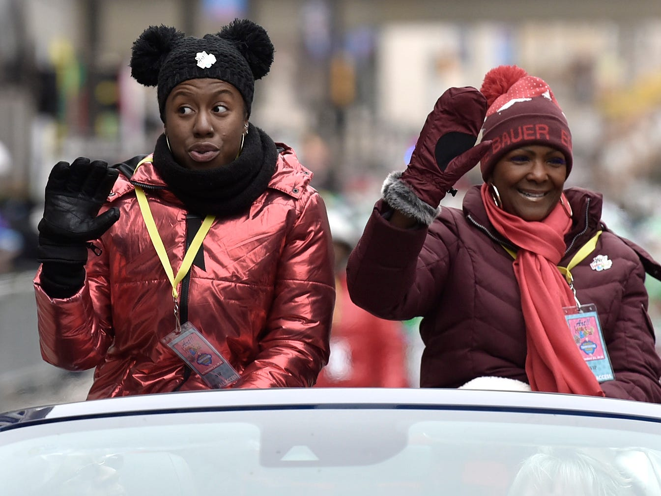 Aretha Franklin's nieces Brooklin Hardeman, left, and Sabrina Owens wave near the end of the parade. .