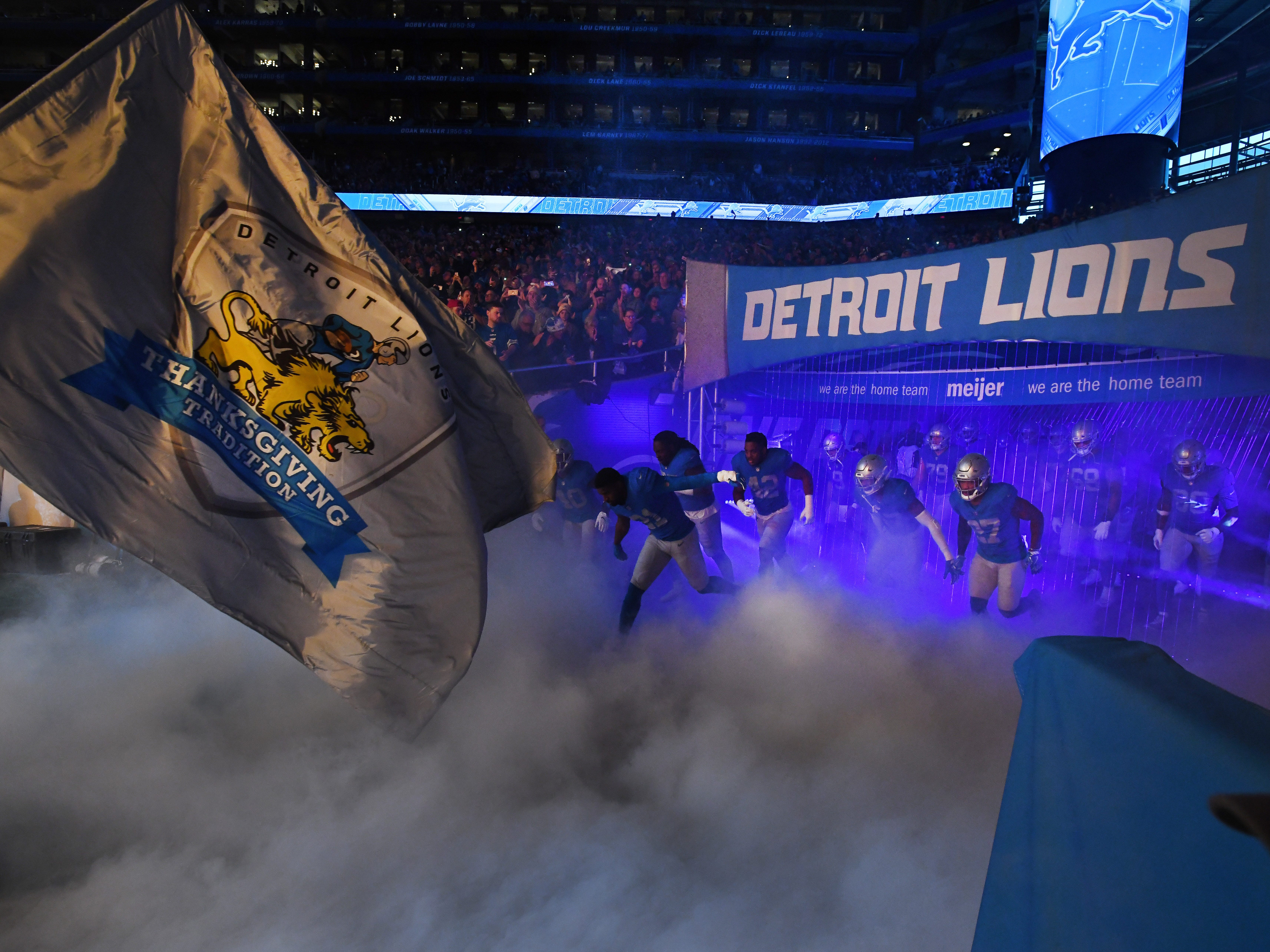 The Detroit Lions charge  out of the tunnel to take on the Chicago Bears on Thanksgiving Day in Detroit.