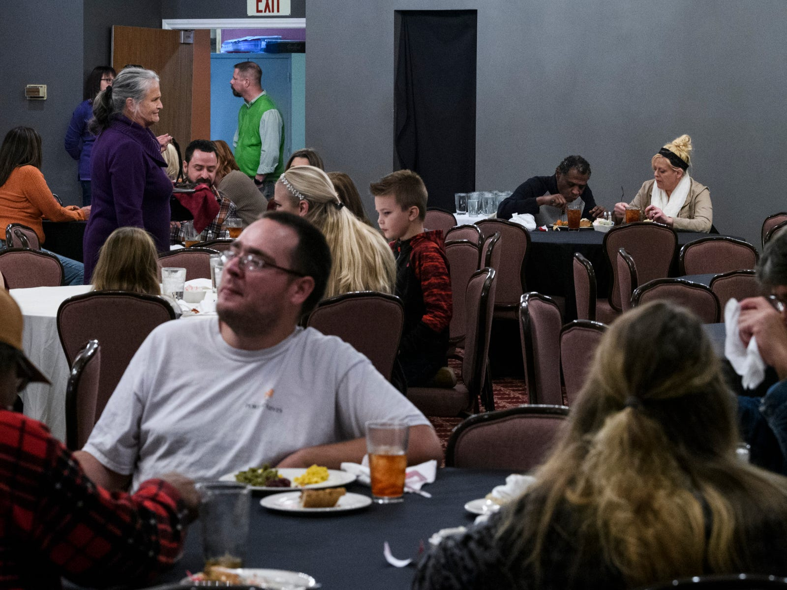 People chat as they enjoy a free thanksgiving meal at Sauced in Evansville's Haynie's Corner Arts District, Thursday afternoon, Nov. 22, 2018. Chefs from Sauced, Bokeh Lounge and Dapper Pig teamed up to offer food from 11 a.m. to 3 p.m. on the Thanksgiving holiday.