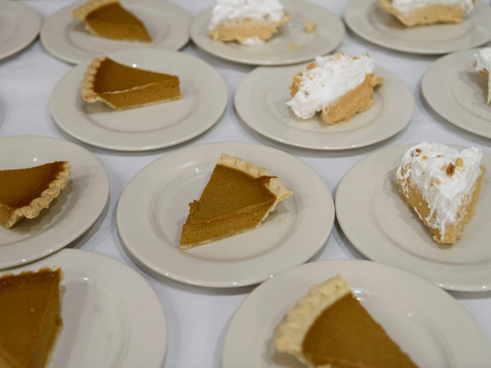 Rows and rows of Peanut Butter, Pecan and Pumpkin pies sit out for people to take during a free Thanksgiving buffet at Sauced in Evansville's Haynie's Corner Arts District, Thursday afternoon, Nov. 22, 2018.