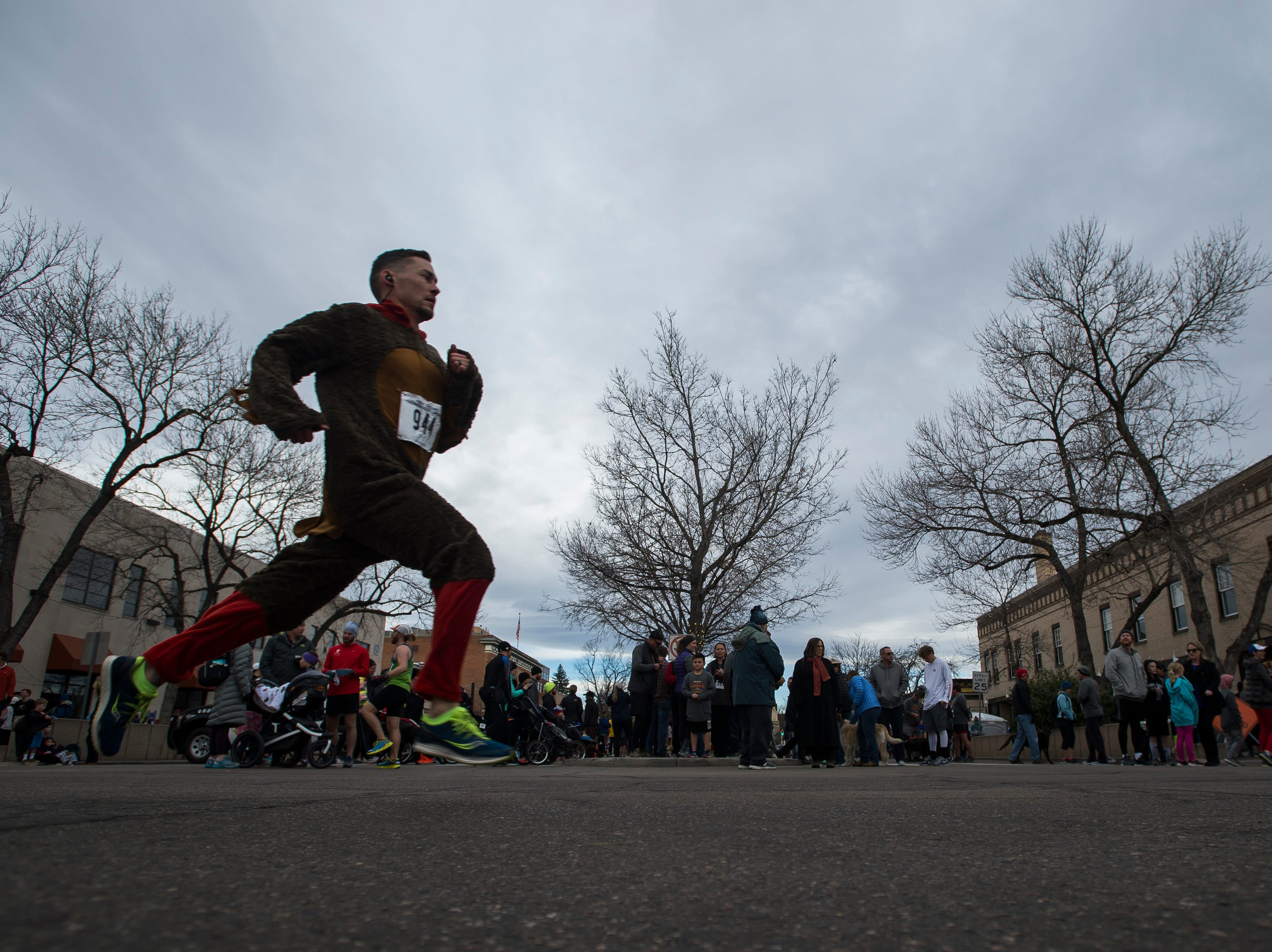 A runner dresses in a festive turkey outfit warms up before the Fort Collins Thanksgiving Day Run on Thursday, Nov. 22, 2018, in Old Town Fort Collins, Colo.