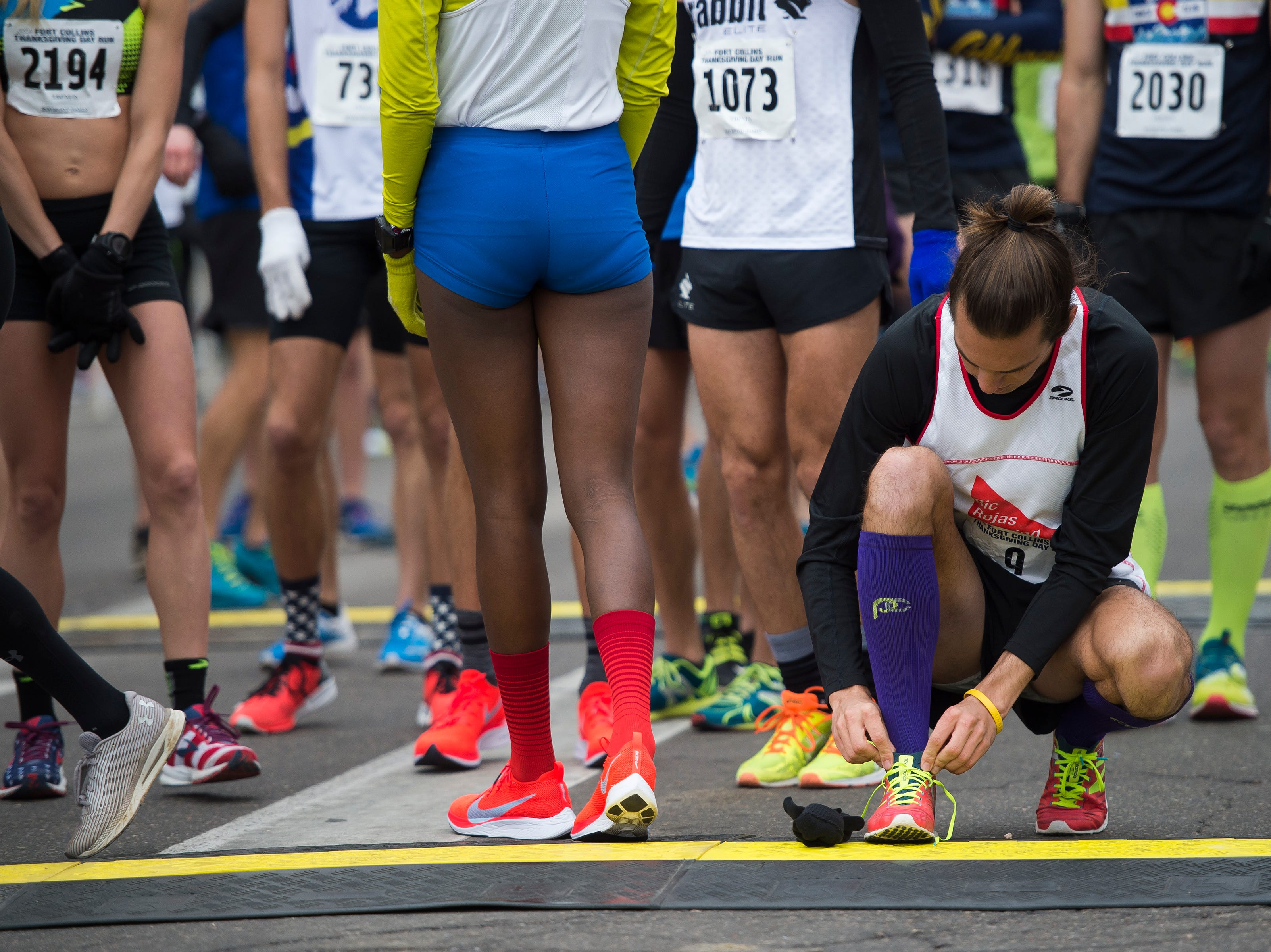 Elite runners prepare for the Fort Collins Thanksgiving Day Run on Thursday, Nov. 22, 2018, in Old Town Fort Collins, Colo.