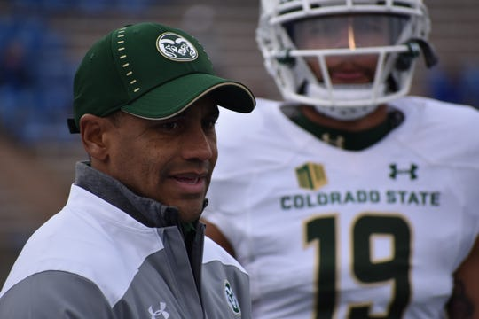 CSU cornerbacks coach Eric Lewis, shown during pregame warmups before a Nov. 22 game at Air Force, is heading to Boston College to become the defensive backs coach there under coach Steve Addazio, FootballScoop.com reported Monday.