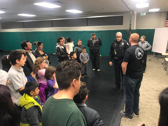 Fort Collins Police Services Lt. Dean Cunningham gives a tour of the police department.