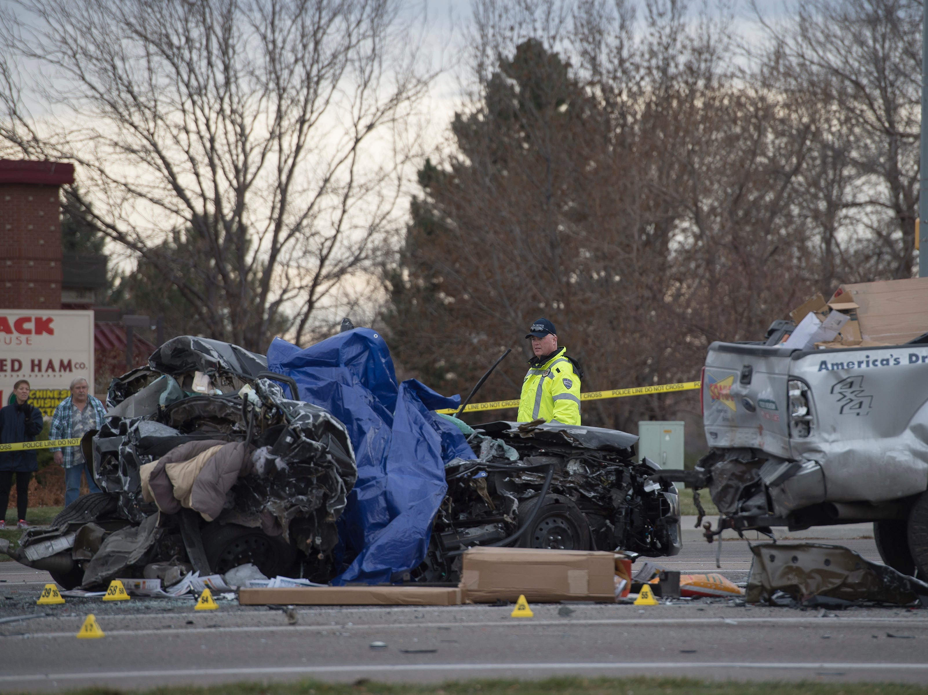 Police work the scene of a crash with multiple fatalities and involving at least four vehicles on Thursday, Nov. 22, 2018, at the intersection of East Harmony Road and East Boardwalk Drive in Fort Collins, Colo.