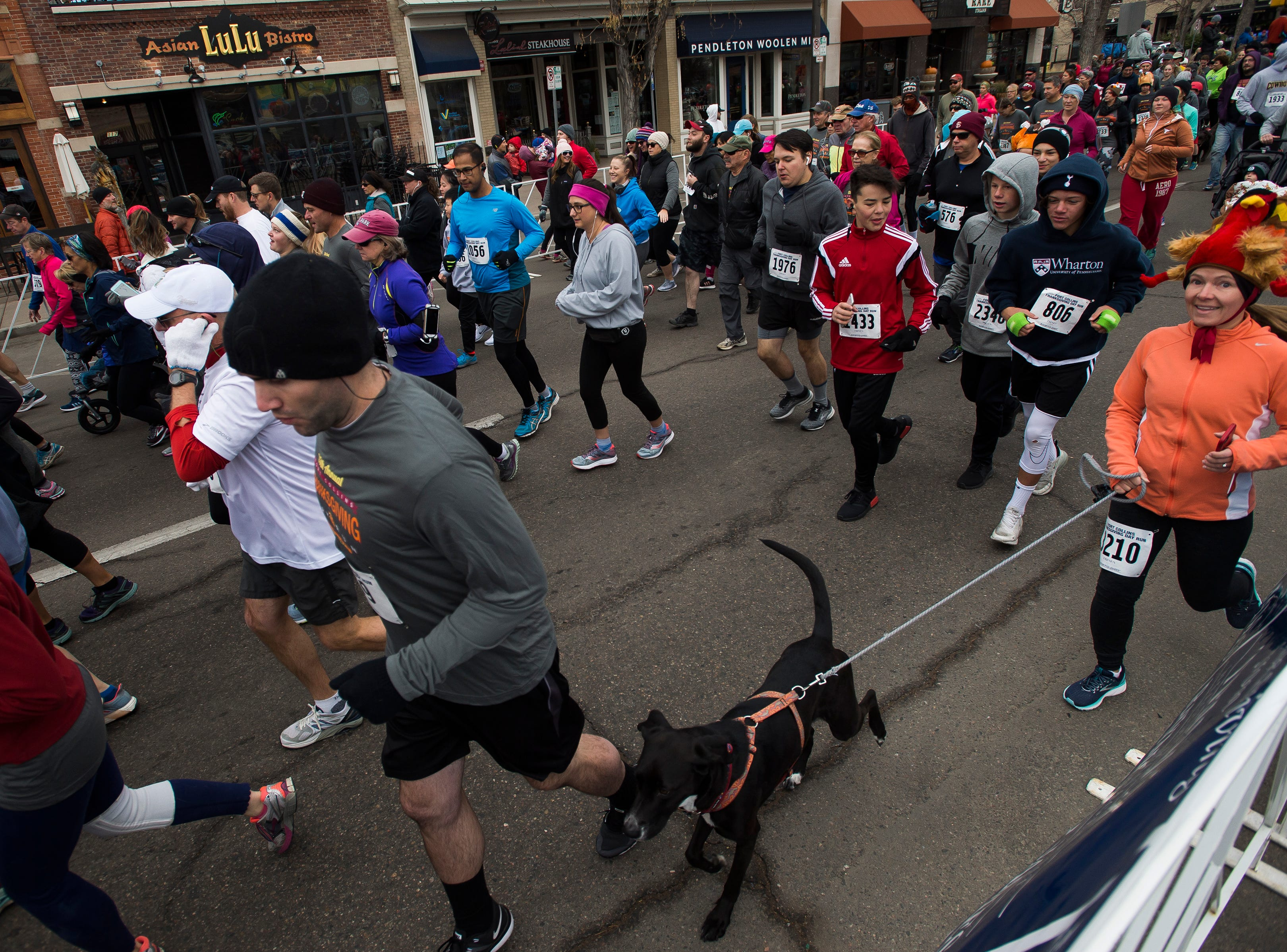 Runners participate during the Fort Collins Thanksgiving Day Run on Thursday, Nov. 22, 2018, in Old Town Fort Collins, Colo.