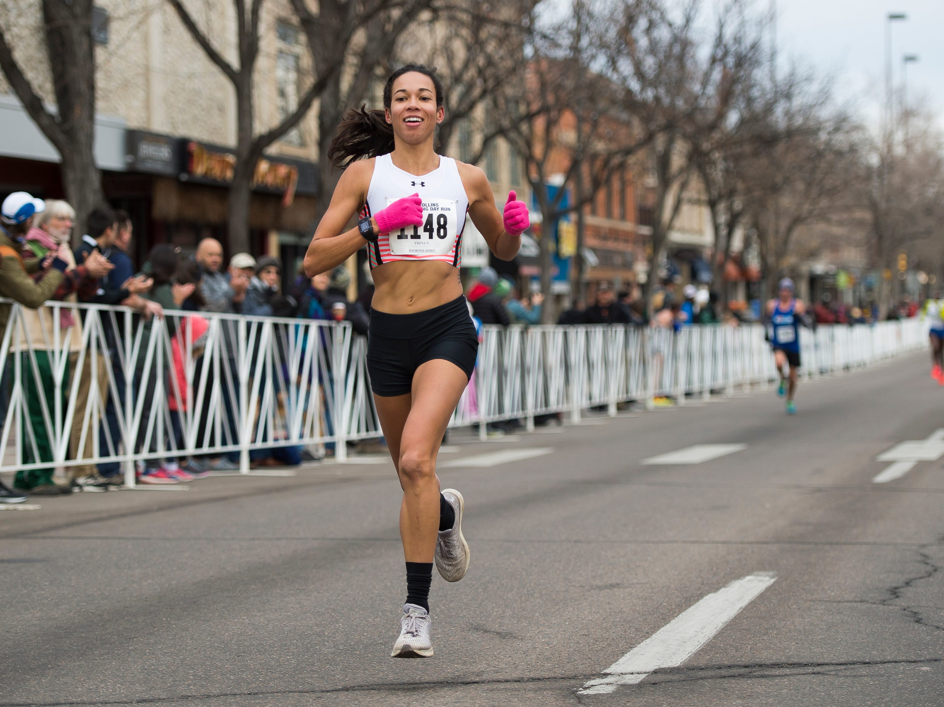 Aisha Praught Leer crosses the finish line to become the first female finisher during the Fort Collins Thanksgiving Day Run on Thursday, Nov. 22, 2018, in Old Town Fort Collins, Colo.