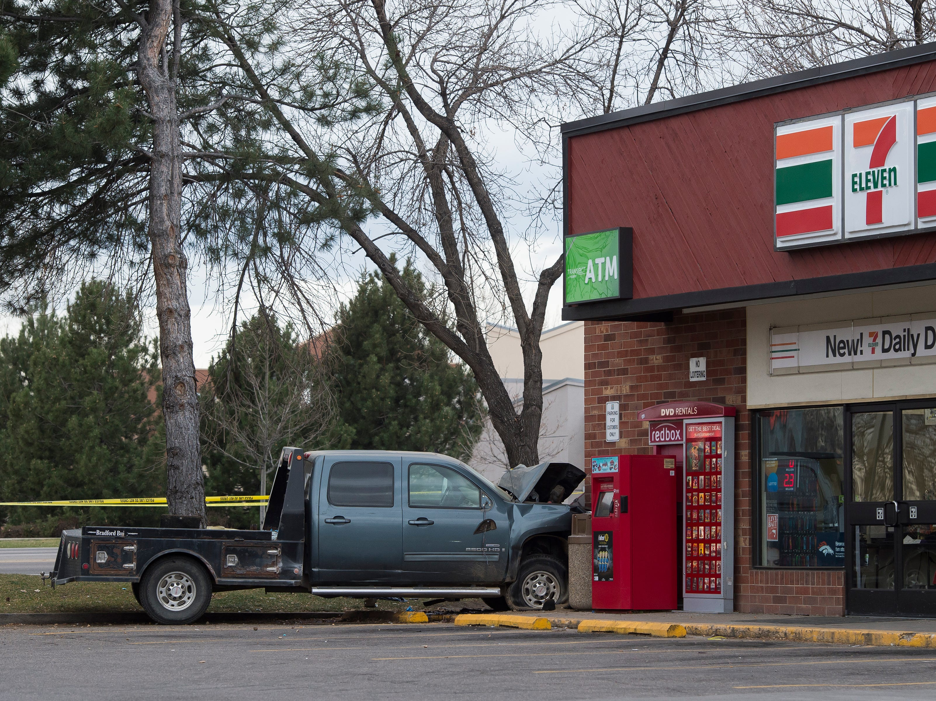 A stolen truck involved in a crash with multiple fatalities and at least four vehicles sits against the corner of a gas station on Thursday, Nov. 22, 2018, at the intersection of East Harmony Road and East Boardwalk Drive in Fort Collins, Colo.