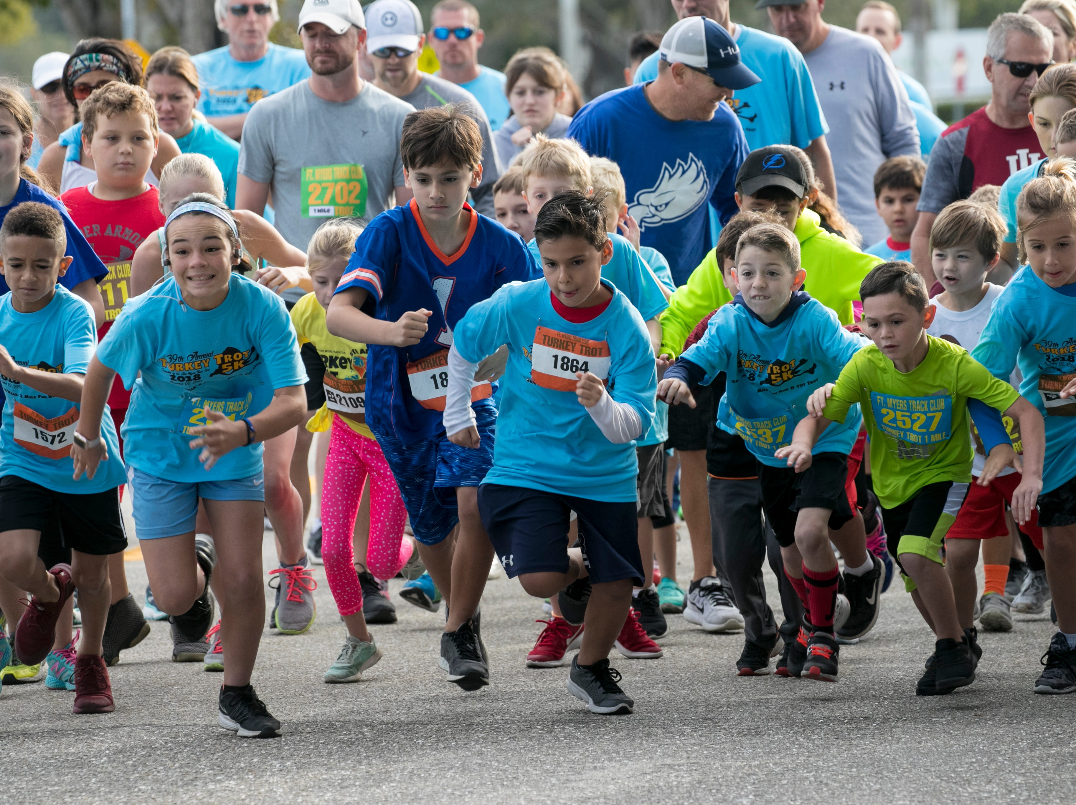 Young runners lead the way at the start of the Turkey Trot 1 Mile run on Thursday, November 22, 2018, in Cape Coral.