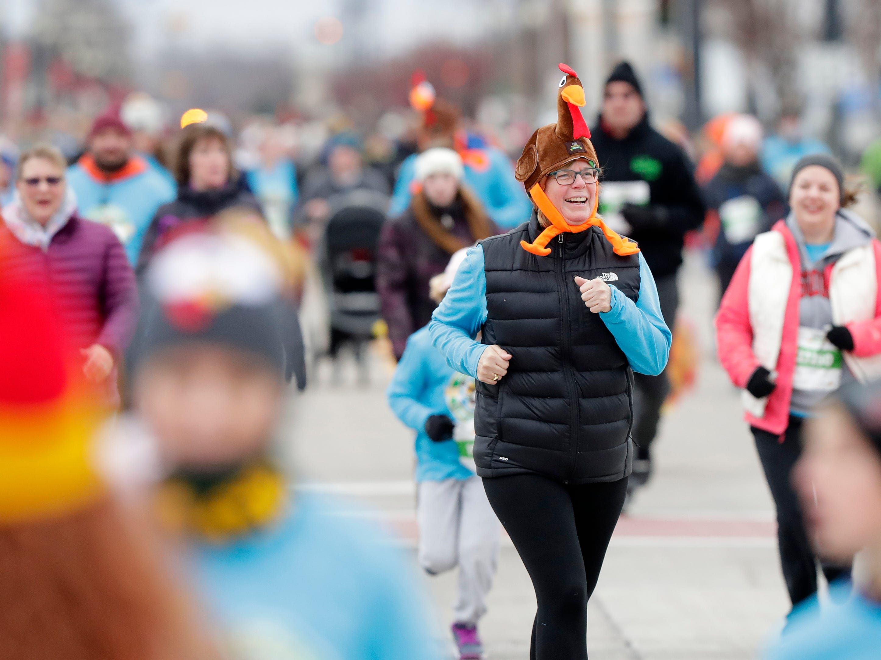 Runners participate in the annual Festival Foods Turkey Trot on Thursday, November 22, 2018 in Ashwaubenon, Wis.