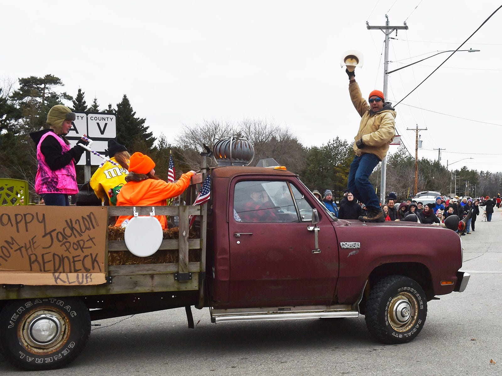 John Czajkowski of Wauwatosa/Jacksonport performing a crazy cowboy dance on the hood of vehicle pulling the Jacksonport Redneck Club float at the Thanksgiving Day Parade in Jacksonport on Thursday, Nov. 22, 2018. Tina M. Gohr/USA TODAY NETWORK-Wisconsin